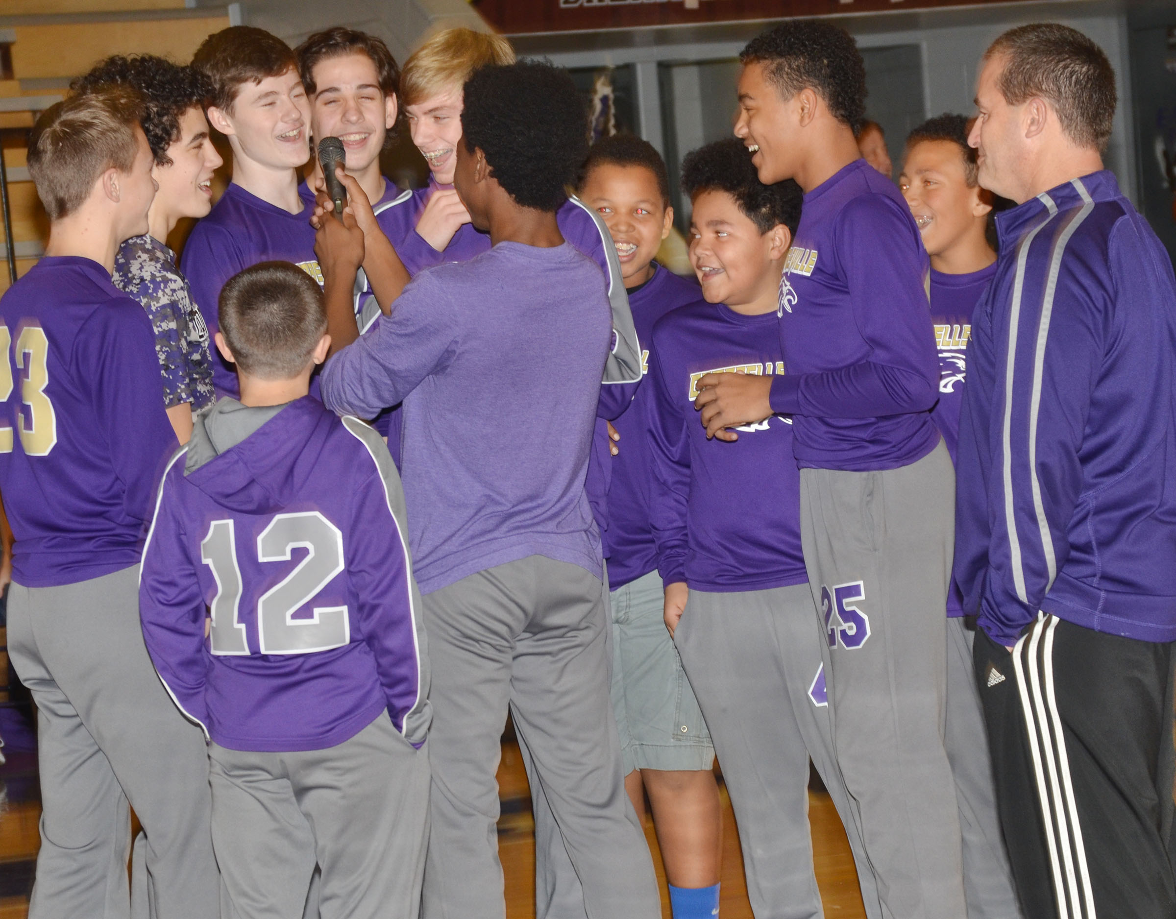 CMS boys' basketball players celebrate their win.