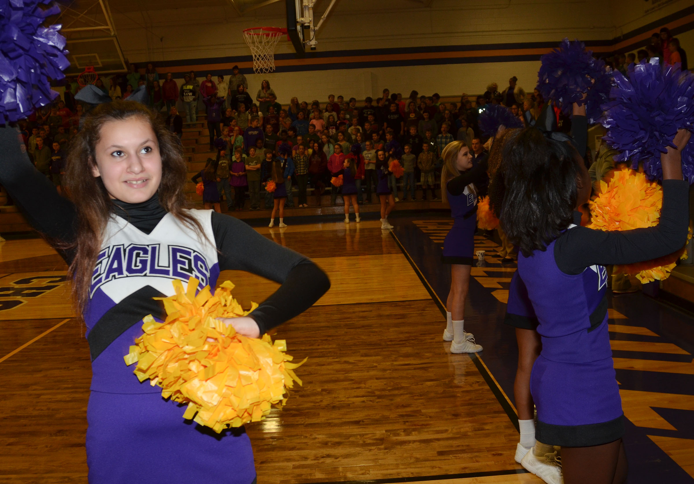 CMS seventh-grader Christina Miller cheers for the Eagles.