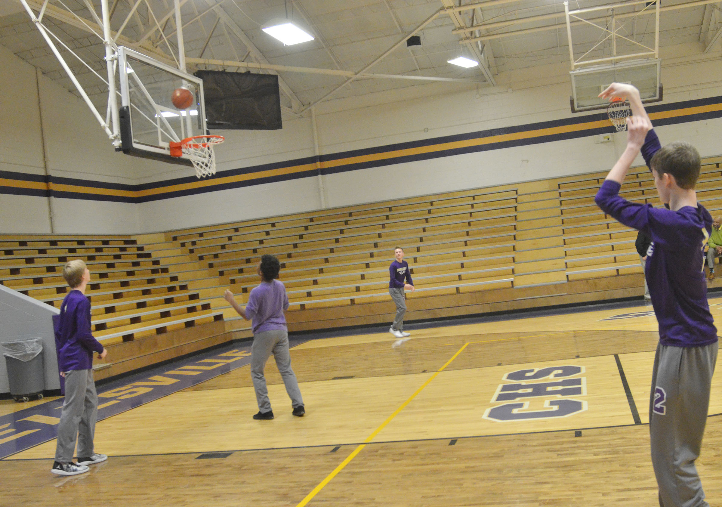 CMS boys' basketball players compete in a spirit game. Eighth-grader Tristin Faulkner, at right, sinks a shot.