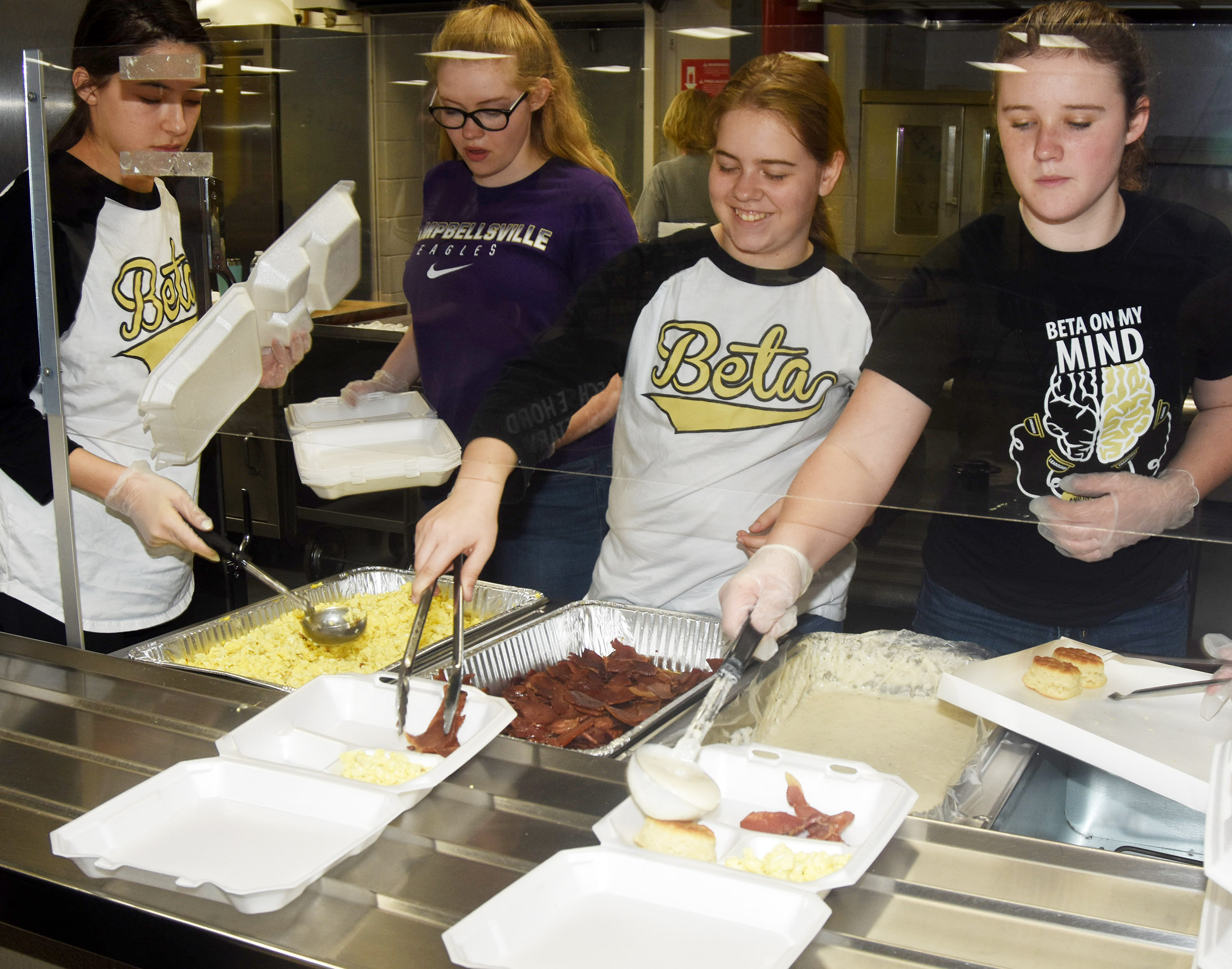 CMS Beta members, from left, eighth-grader Kaylyn Smith, seventh-grader Whitney Frashure, sixth-grader Layla Steen and eighth-grader Abby Brisko serve breakfast.
