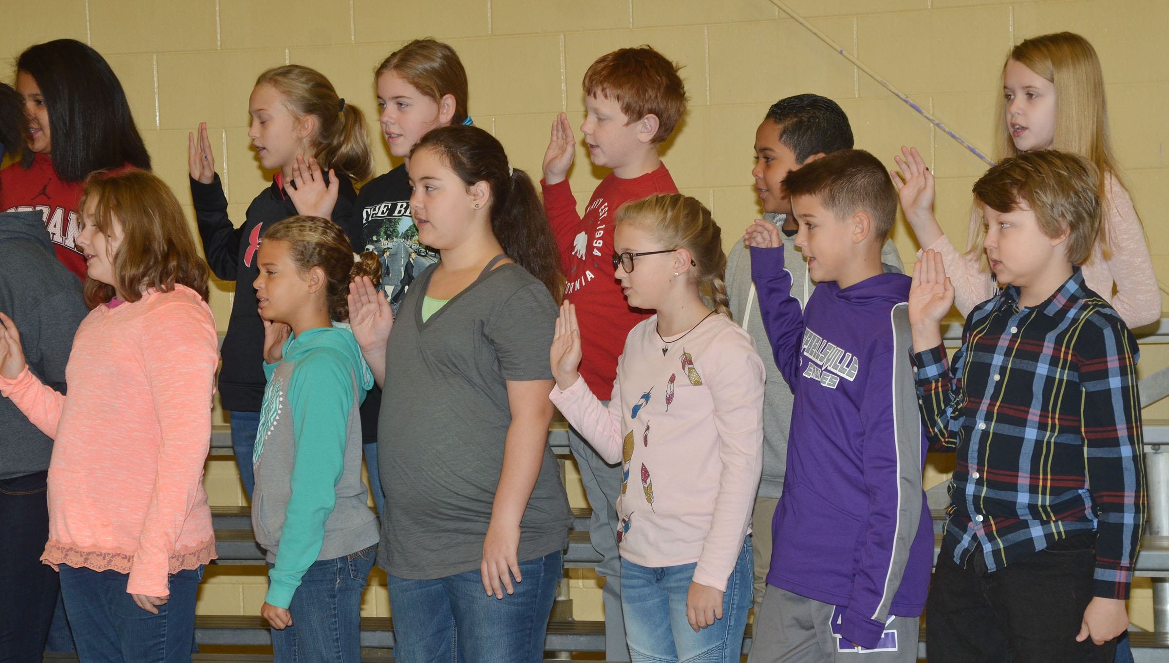 New CMS Beta members recite the club pledge.