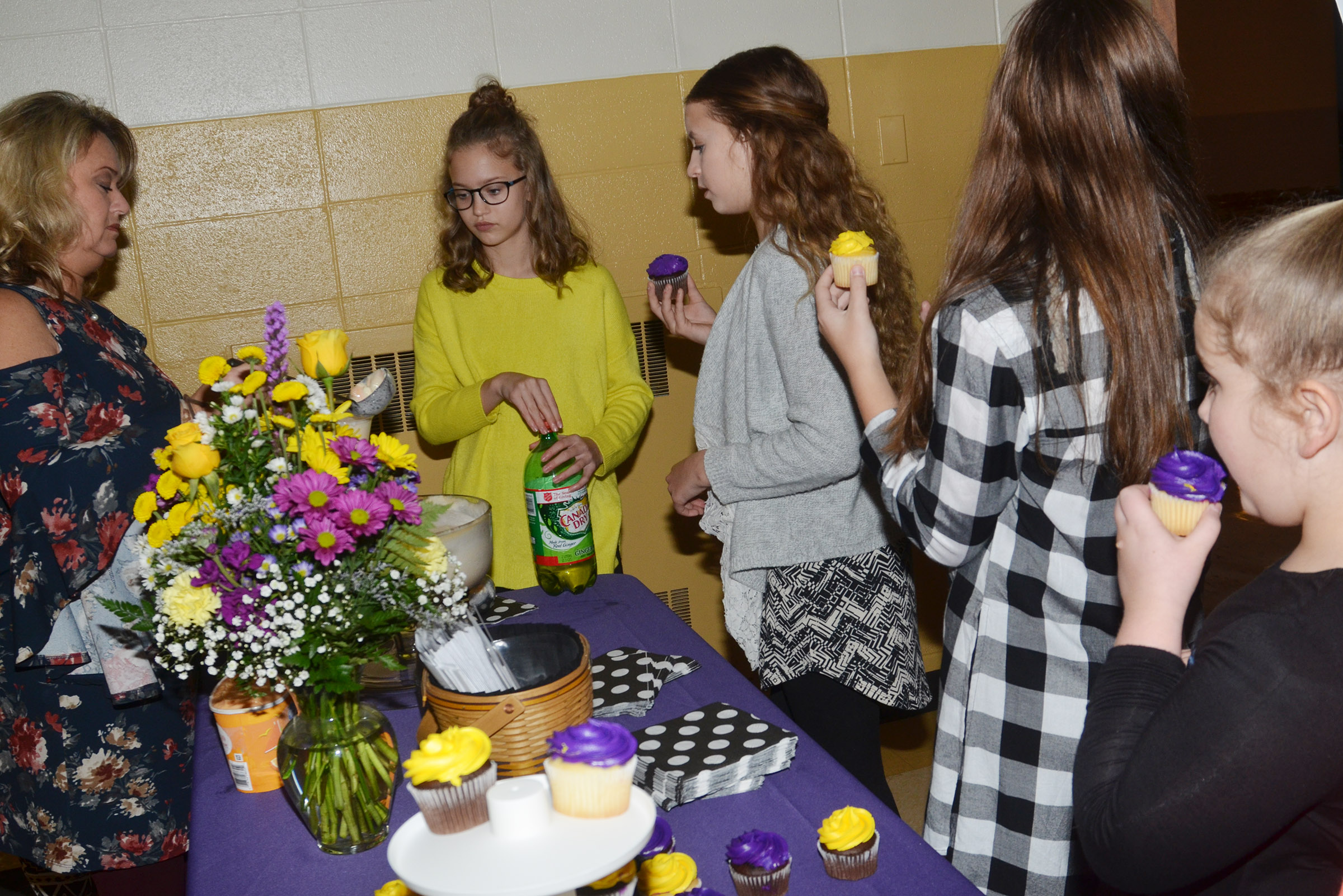 CMS Beta members are treated to cupcakes and punch after the induction ceremony.