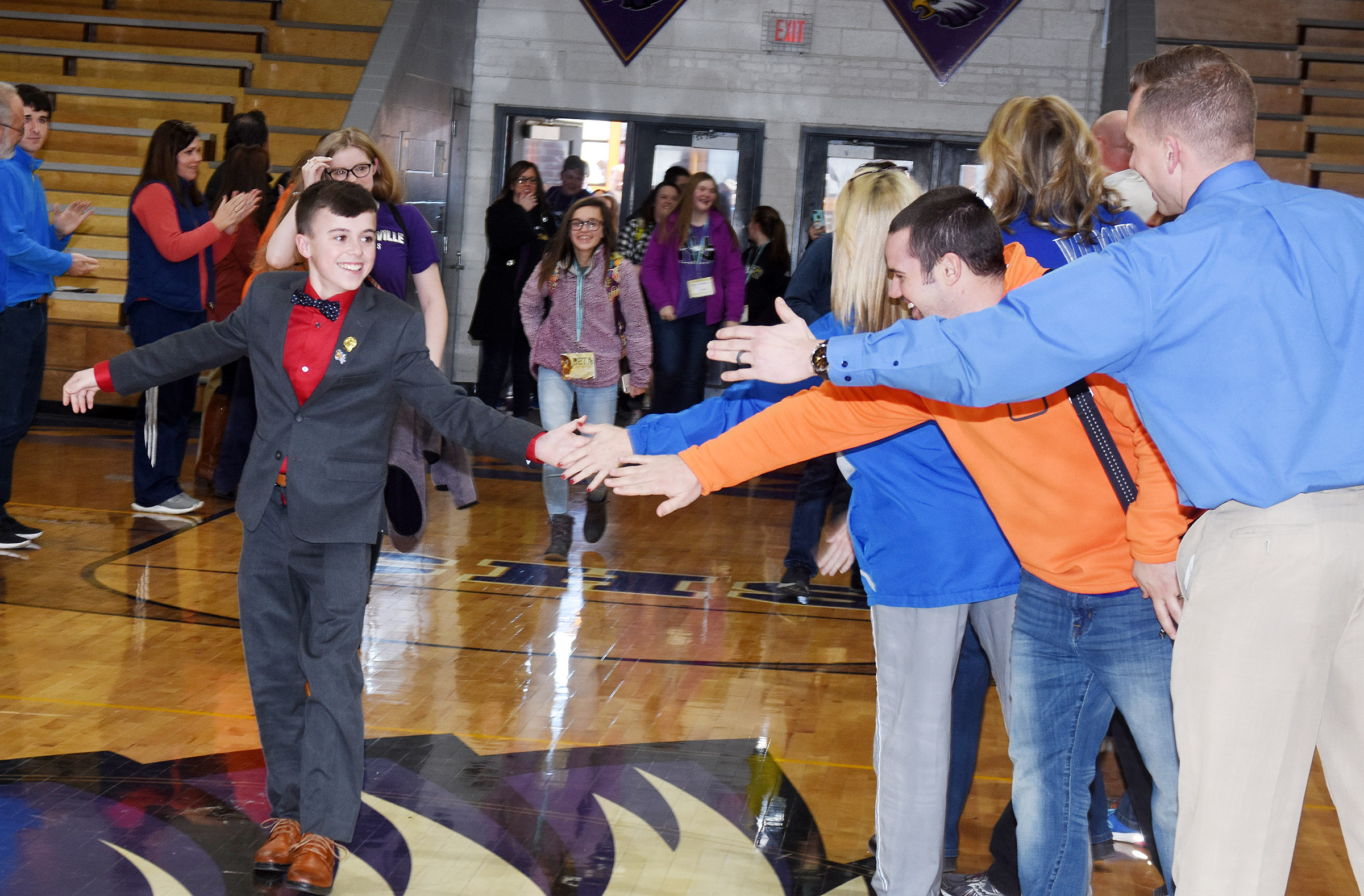 Seventh-grader Chase Hord, center, was elected secretary at the Kentucky Junior Beta convention and becomes the first CMS student to win a state office. He and his fellow Beta members were welcomed home by their teachers and classmates.
