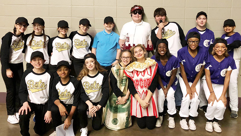 CMS Beta members pose for a photo together before performing their skit in support of seventh-grader Chase Hord's campaign for secretary. From left, front, are eighth-grader Dakota Harris, seventh-grader Zamar Owens, eighth-grader Rylee Petett, sixth-grader Chloe Thompson and eighth-graders Christina Miller, Myricle Gholston, Bri Gowdy and Alexis Thomas. Back, eighth-graders Sarah Adkins, Lainey Watson, Tayler Thompson, Kaylyn Smith, Adin Hunt, Blake Settle, Logan Rakes and Jack Sabo and seventh-grader Ronin Smith.