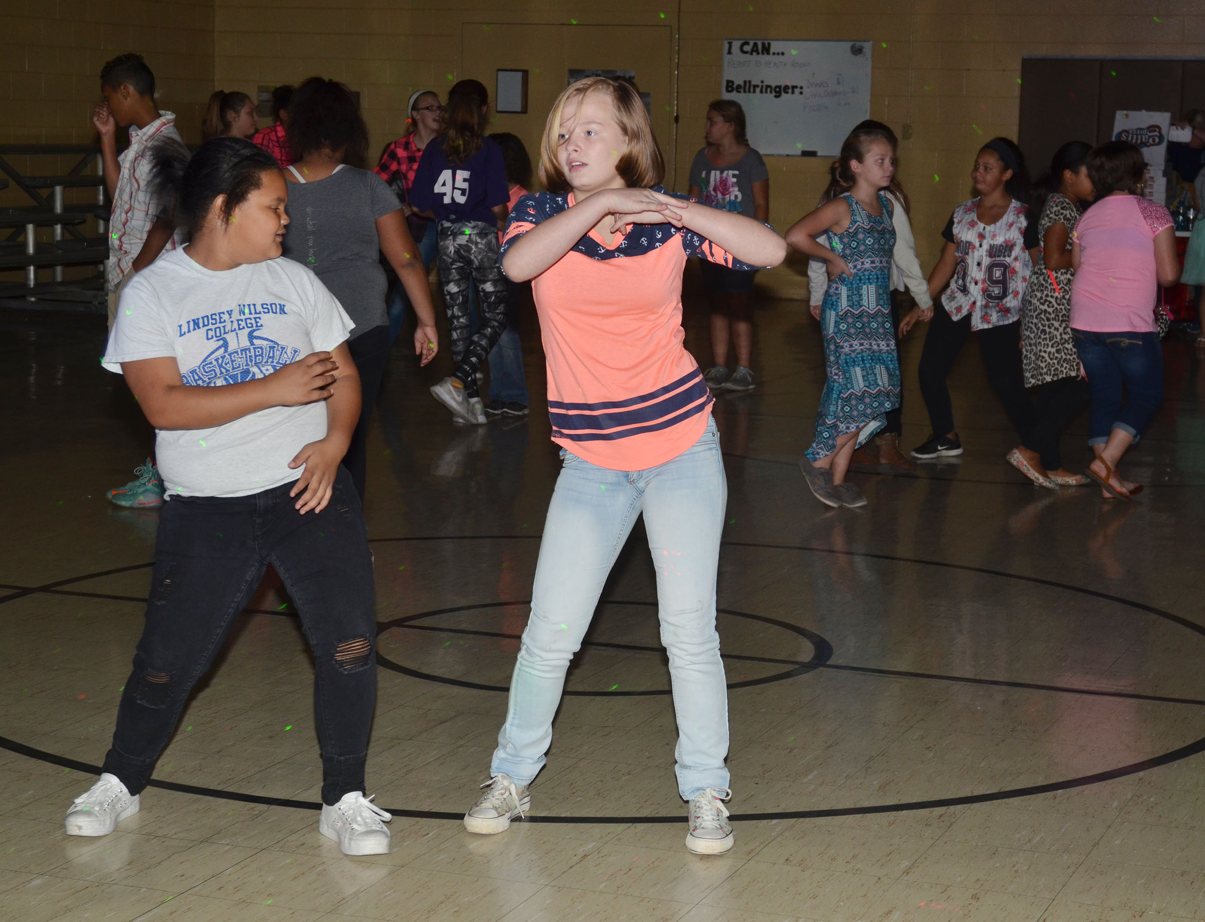 CMS fifth-grader Ellena Taylor, at left, and sixth-grader Davanna Reardon dance.