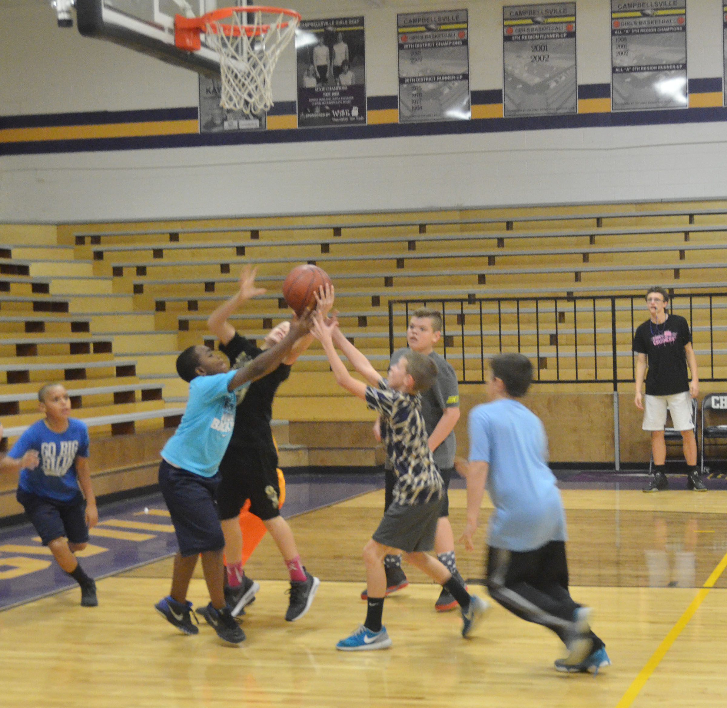 CMS students battle for a rebound.