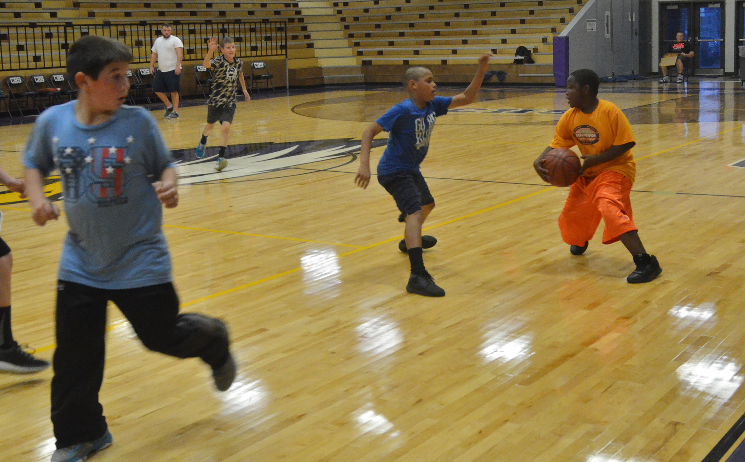 CMS fourth-grader Temarieon Warren dribbles to the basket.