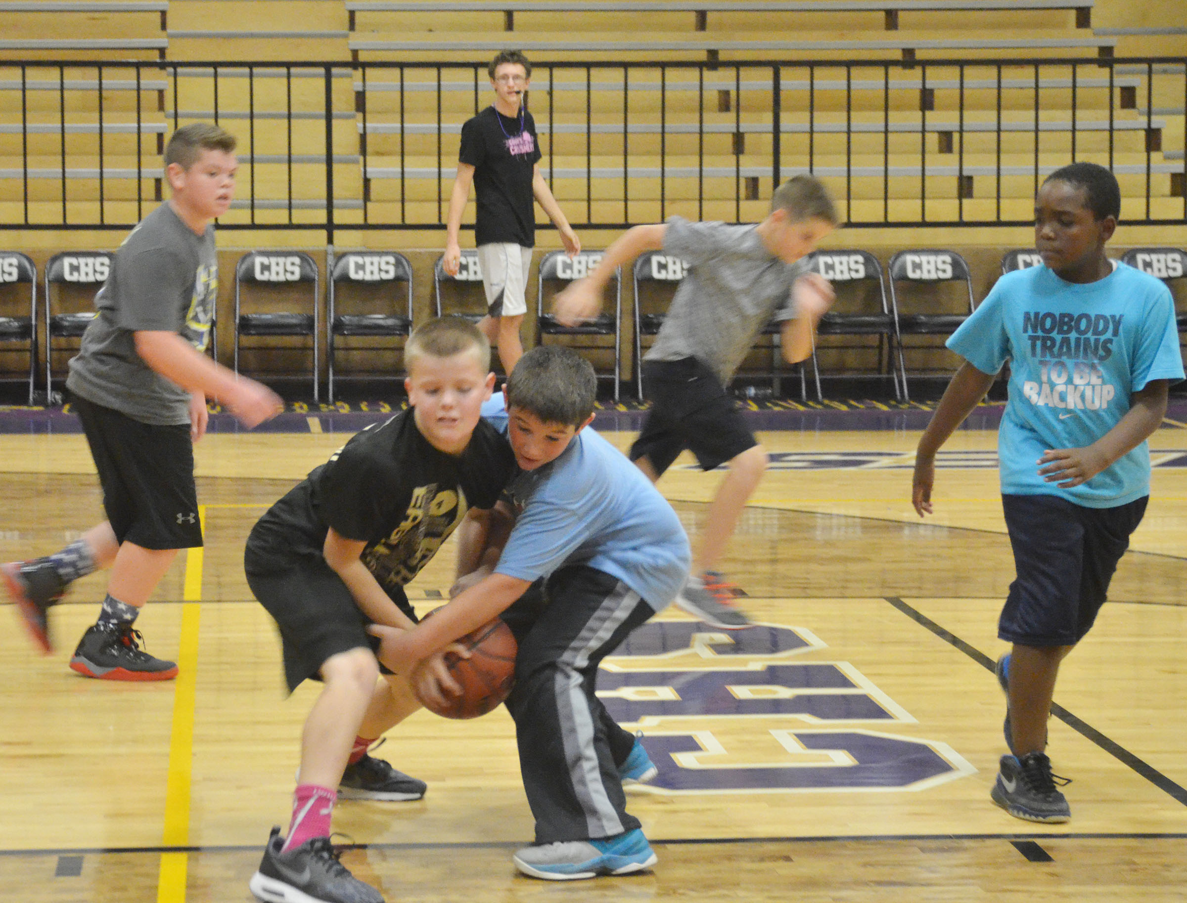 CMS sixth-grader Konner Forbis, at left, and fourth-grader Kace Eastridge battle for the ball.