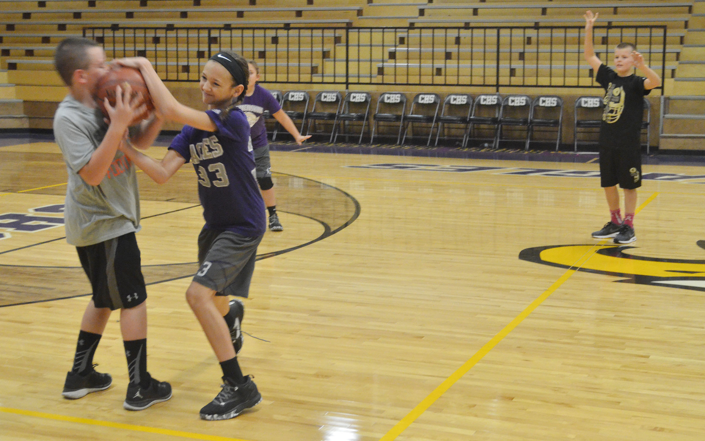 CMS sixth-graders Jacob Judd and Bri Hayes fight for the ball.