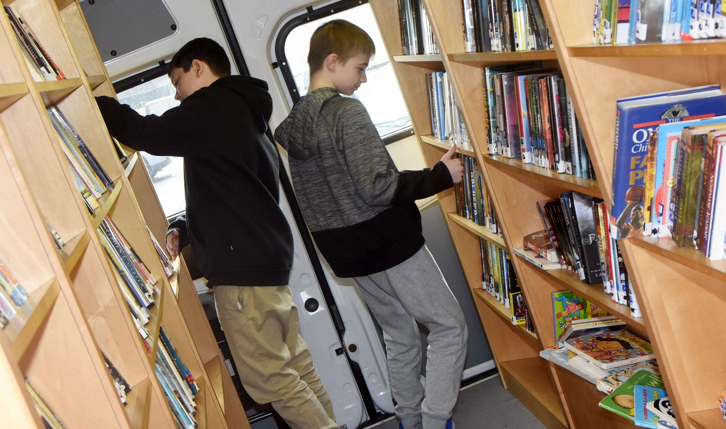 CMS seventh-graders Gregory Burton, at left, and Ethan Cox browse books on the bookmobile.