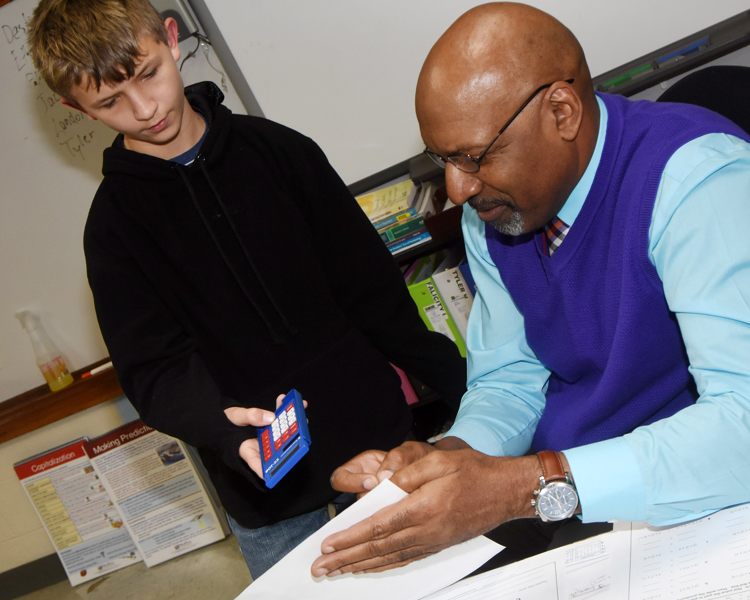CMS exceptional child educator Chop Bridgewater helps sixth-grader Tyler Haulk with a multiplication problem.
