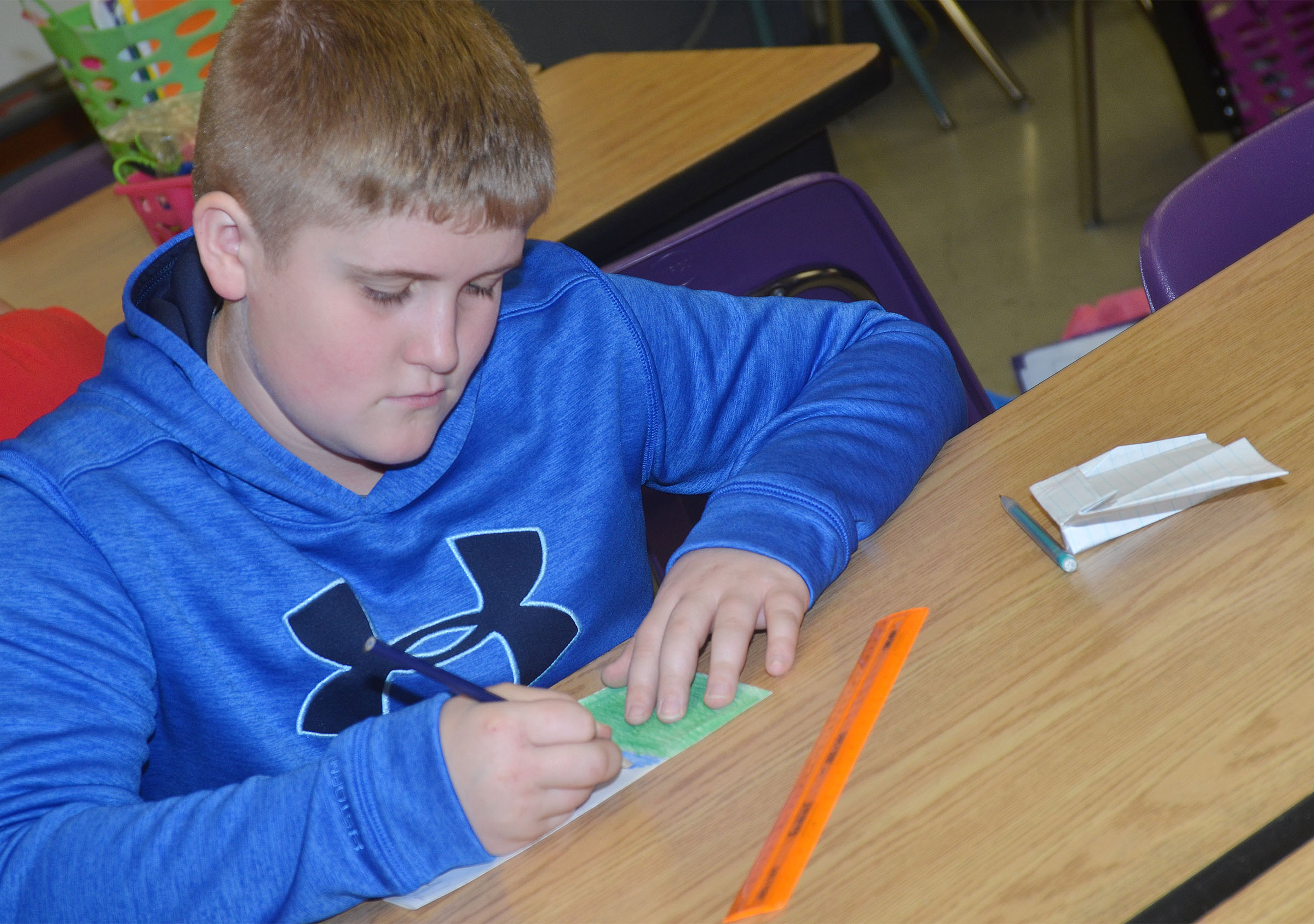 CMS fifth-grader Lance Knifley makes a card for Cafeteria Appreciation Day.