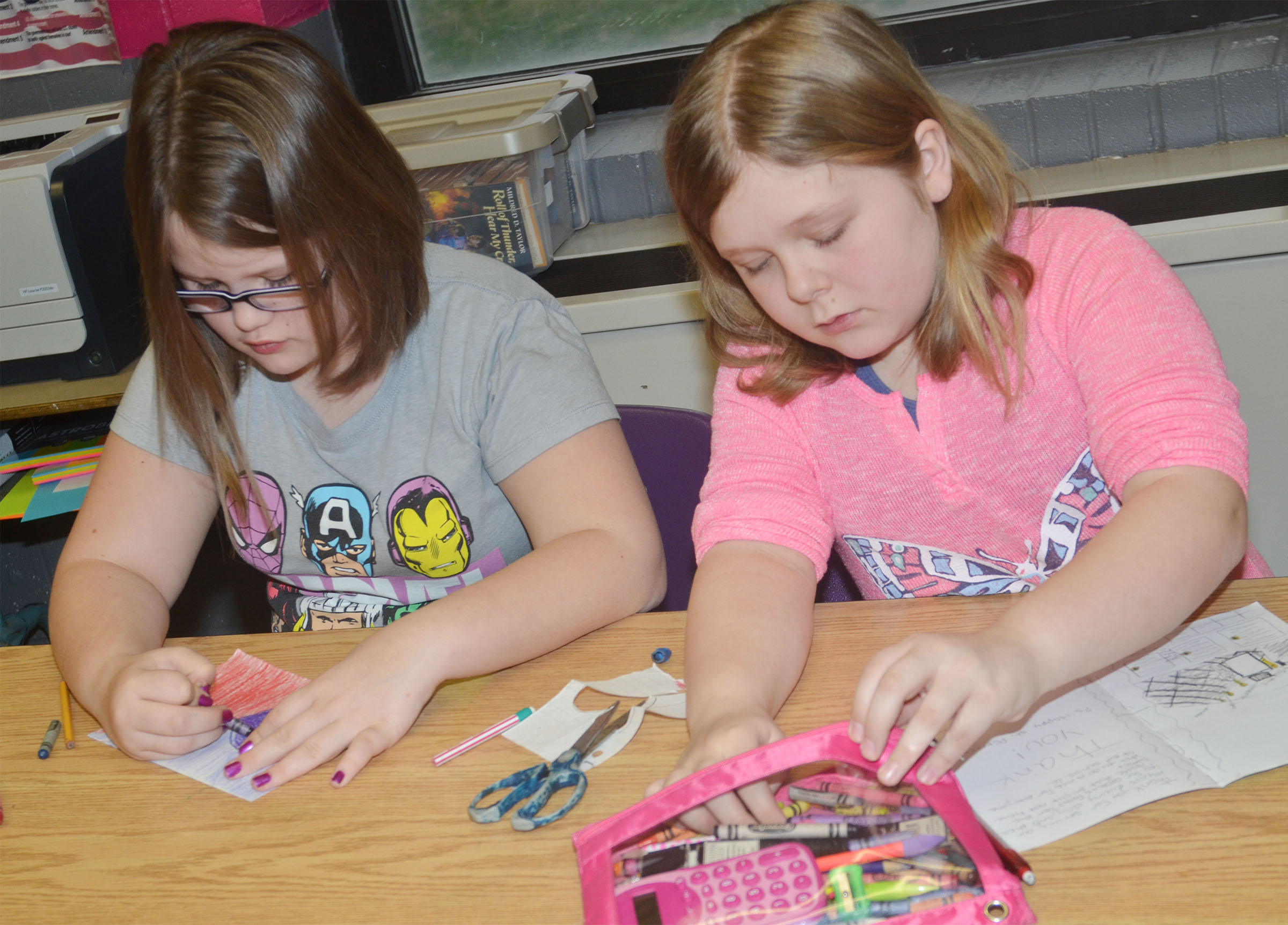CMS fifth-graders Kylee Cox, at left, and Alexis Sharp make Cafeteria Appreciation cards.