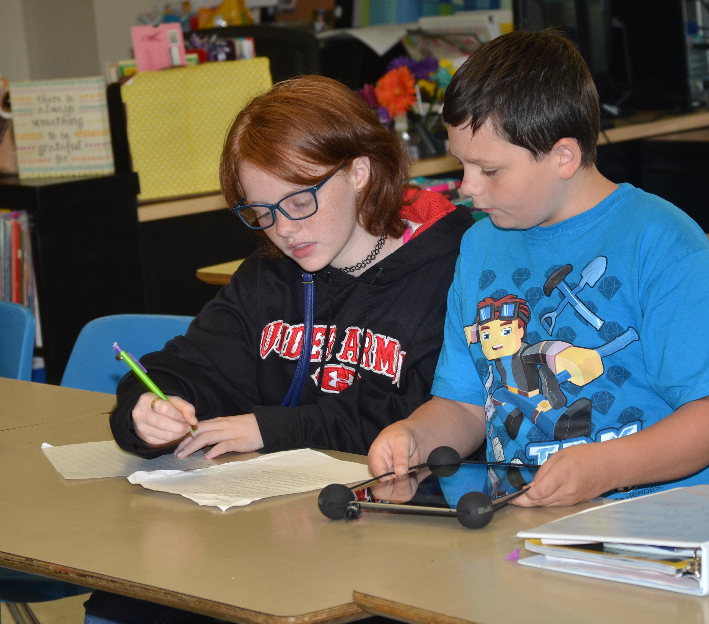 CMS sixth-graders Haley Gutierrez and Gregory Burton work a math problem.