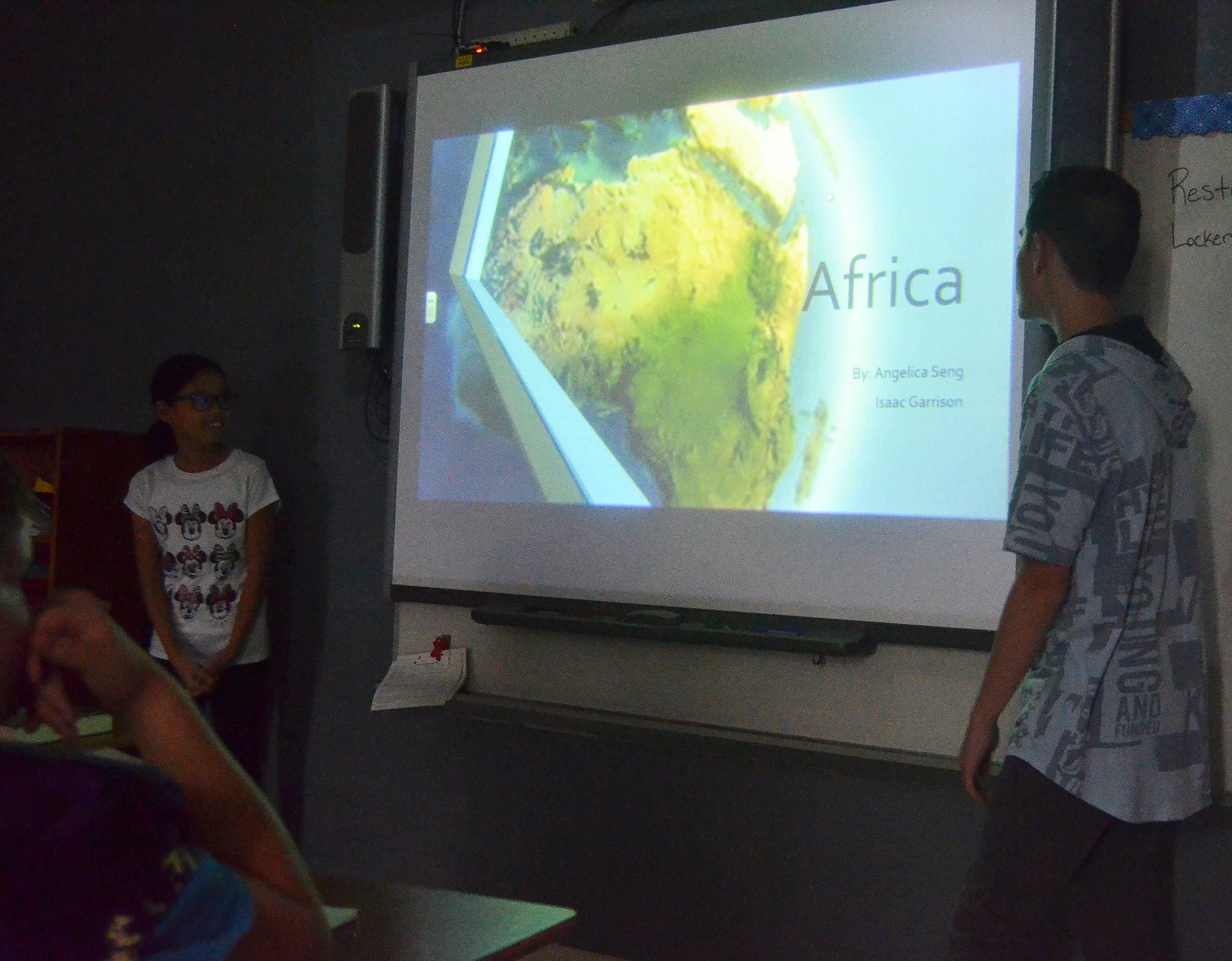 CMS sixth-graders Angelica Seng, at left, and Isaac Garrison talk to their classmates about Africa.