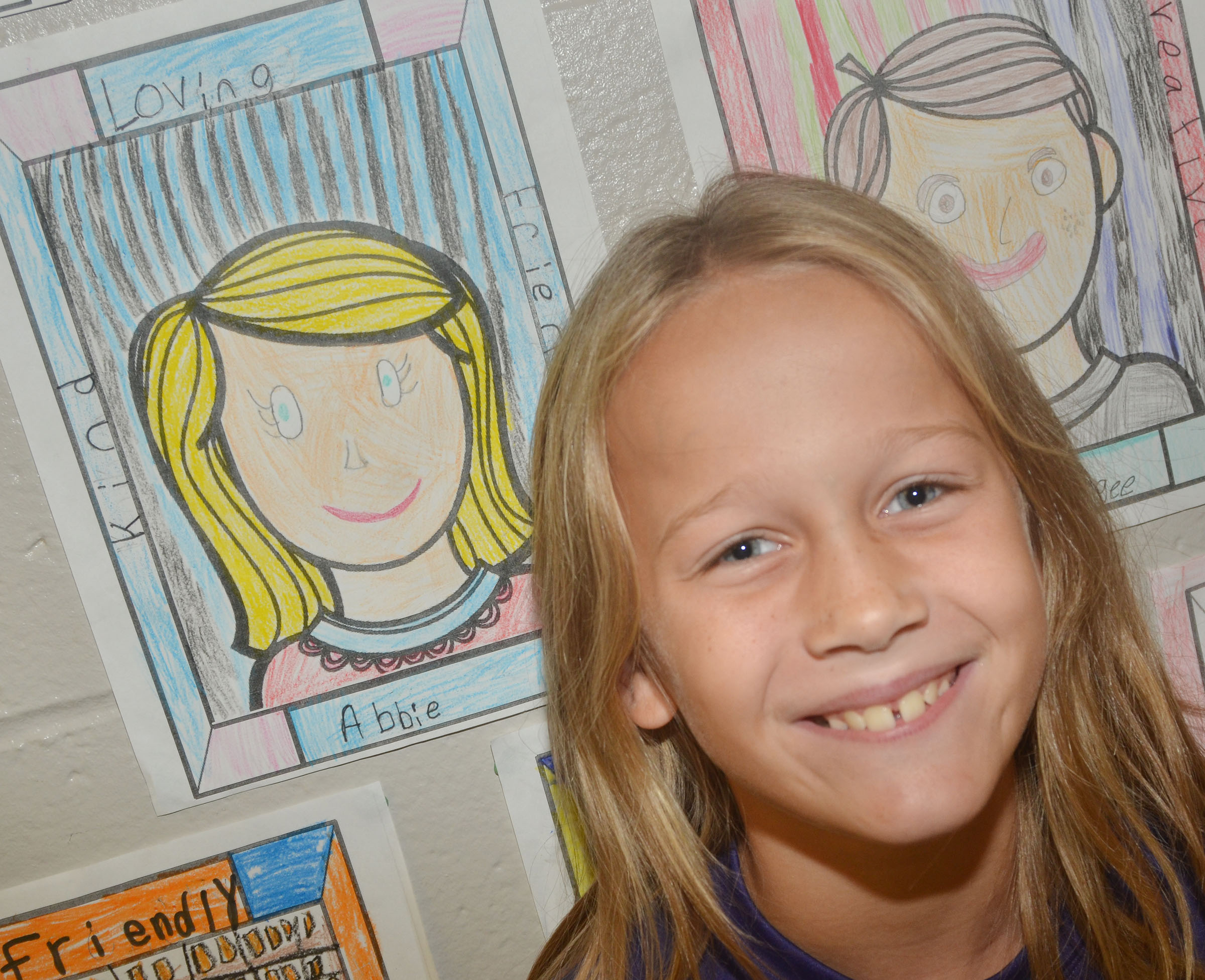 CMS fourth-grader Abbie Oliver poses by her character traits self-portrait.