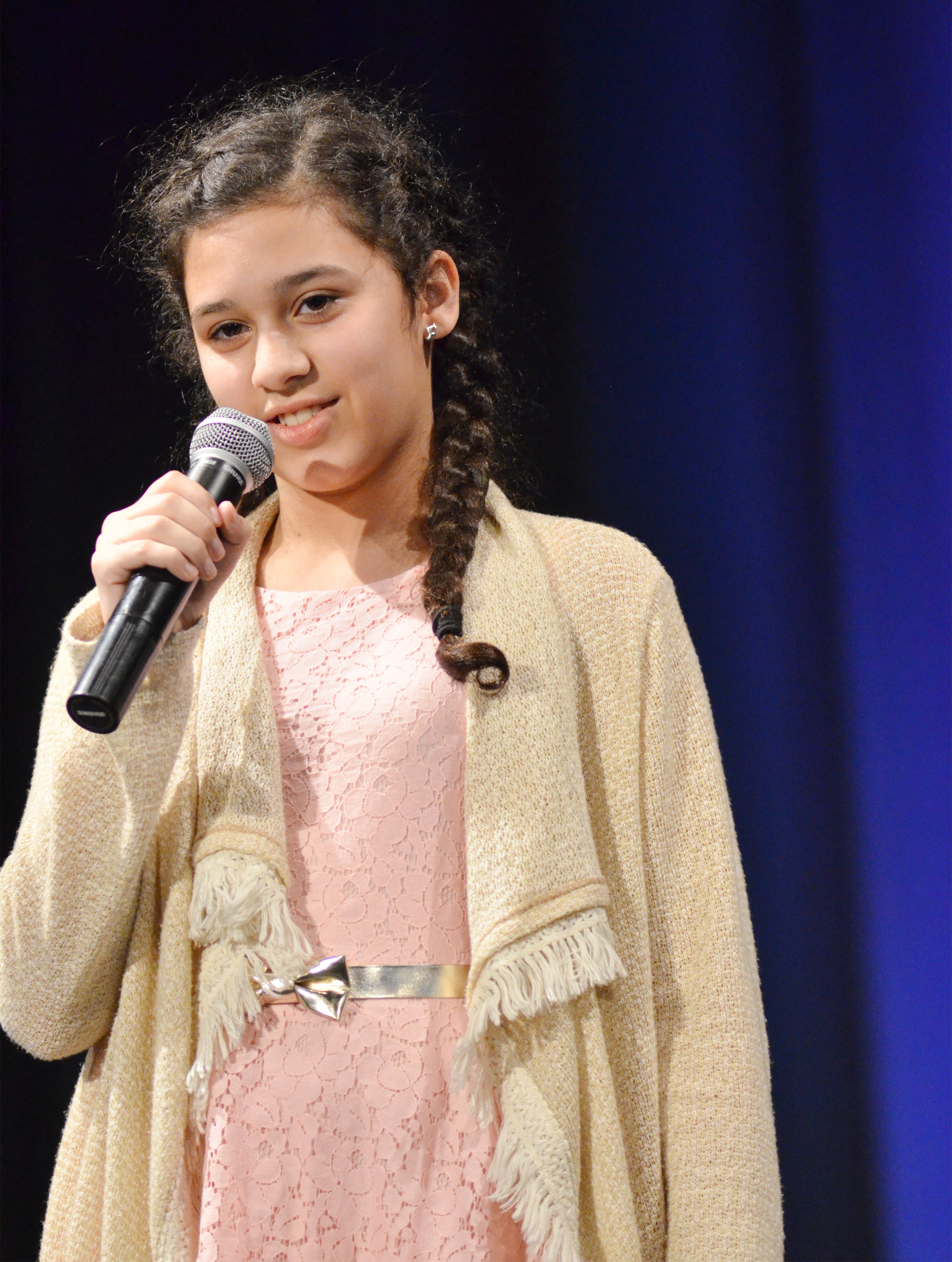 CMS seventh-grader Bia Moura sings.