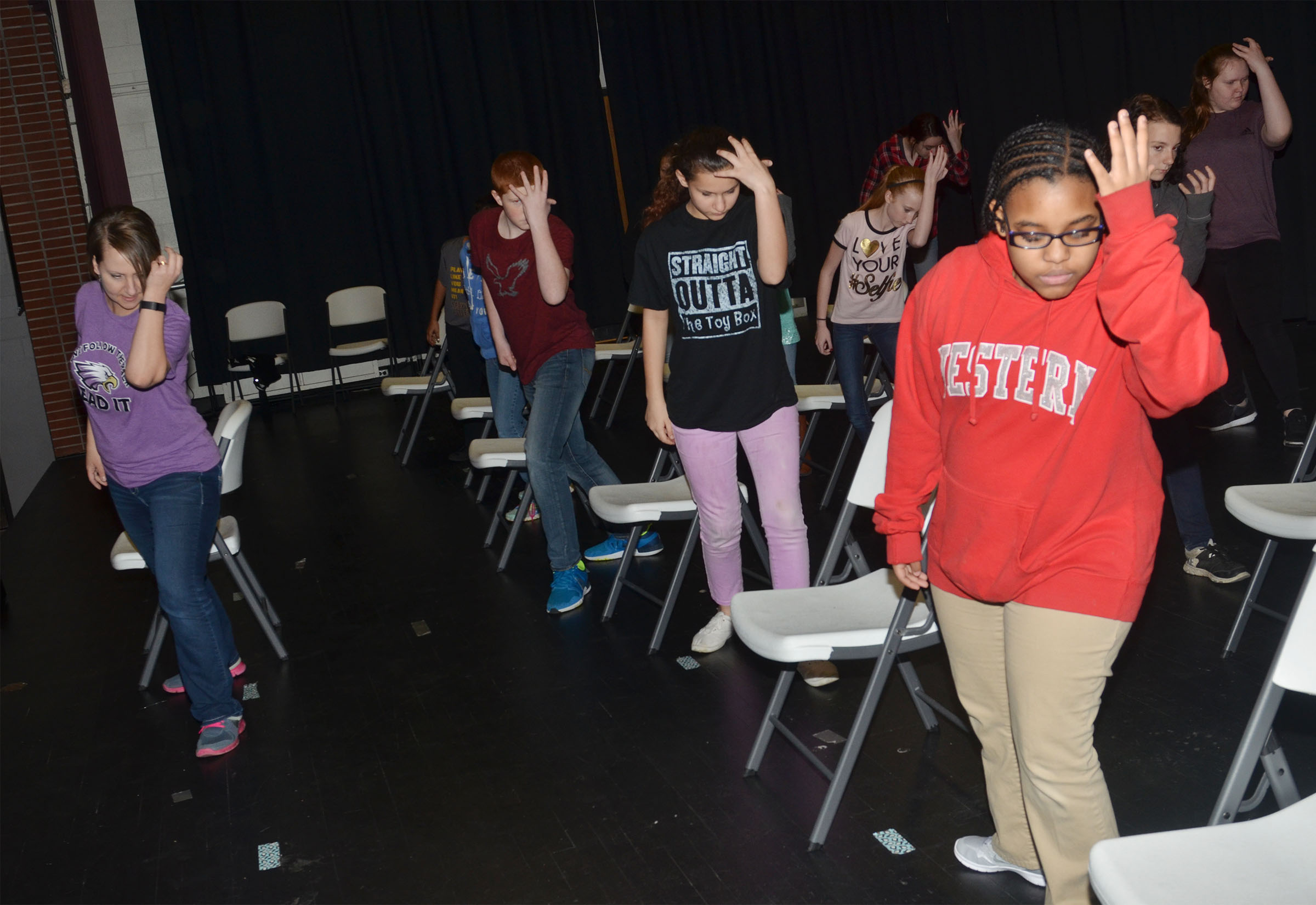 CMS choir director Jessica Floyd, at left, teaches choreography.