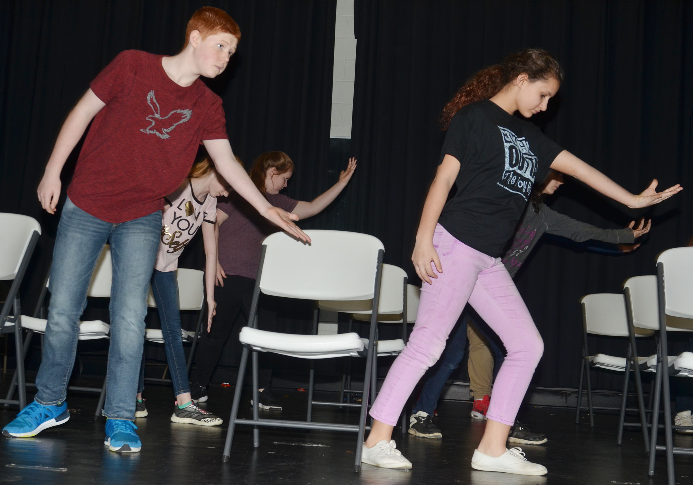 CMS eighth-grader Colin Harris, at left, and seventh-grader Christina Miller dance.