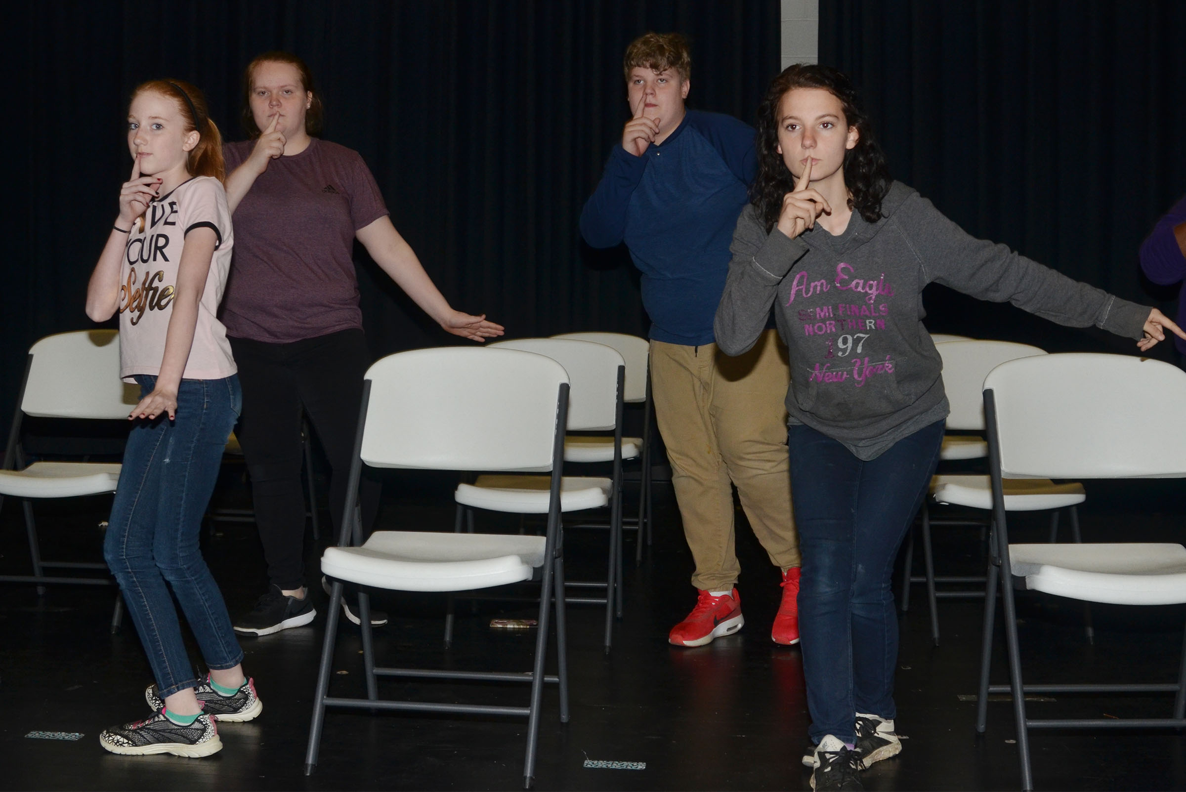 From left, CMS choir members Hayley Wethington, a seventh-grader, and eighth-graders Trinity Lobb, Noah Mardis and Natasha Combs practice choreography for their spring show.