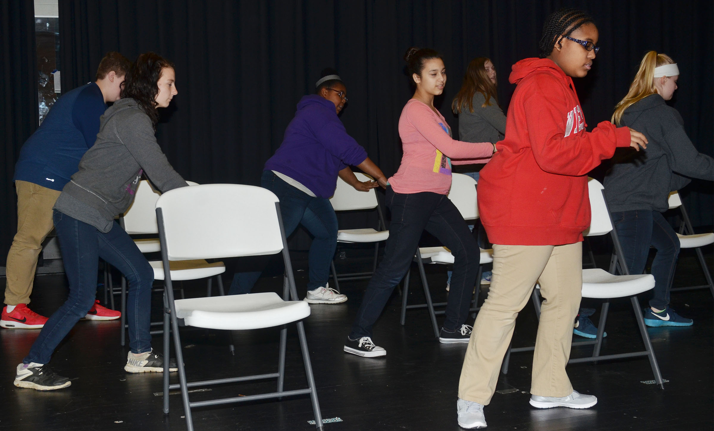 CMS eighth-grader Jasmine Mitchell, in front, leads her fellow choir members as they practice choreography.