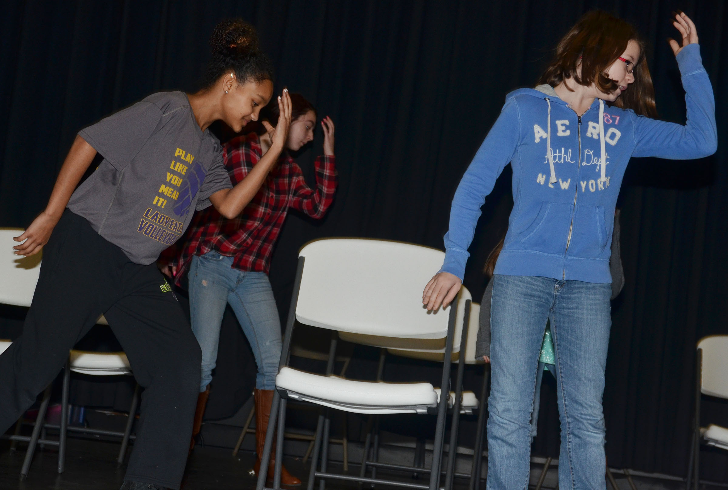 CMS seventh-graders Alexis Thomas, at left, and Liberty Albrecht practice choreography.