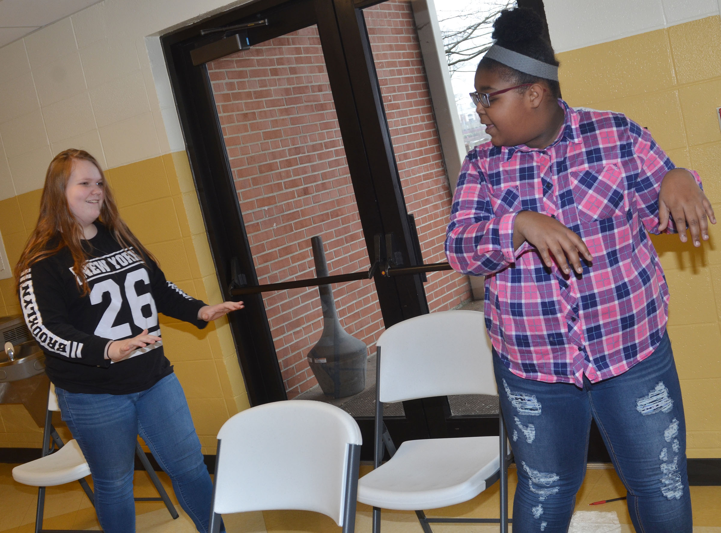 CMS eighth-graders Trinity Lobb, at left, and Destany Lane practice their chair routine for the variety show.