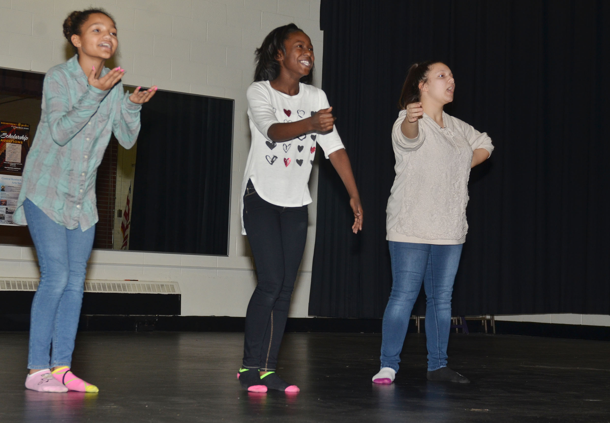 From left, CMS seventh-graders Alexis Thomas and Myricle Gholston and eighth-grader Tierra Bridgewater practice their choreography.