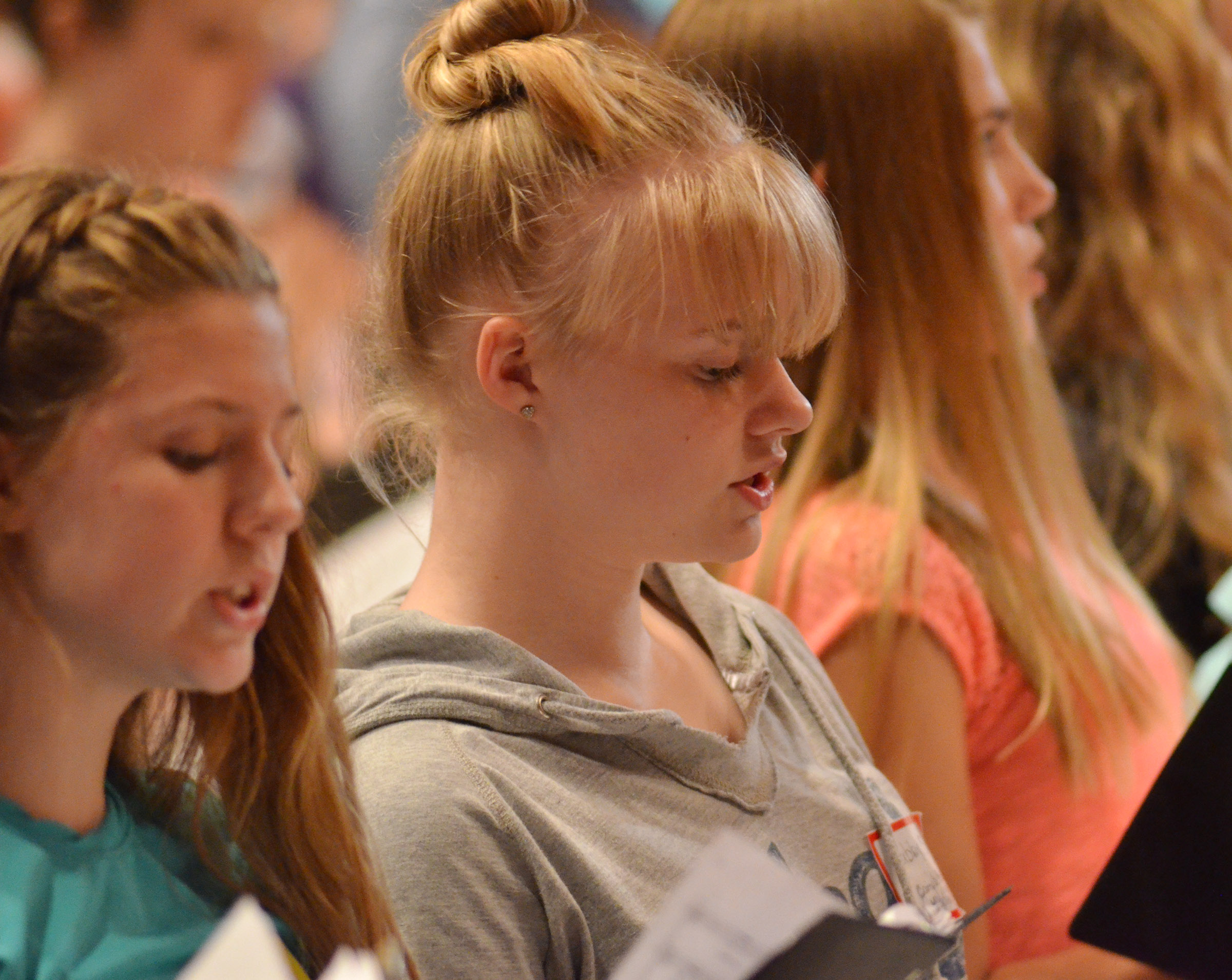 CMS seventh-grader Alysa Howard, at left, and eighth-grader Gabby Skaggs sing during rehearsal.