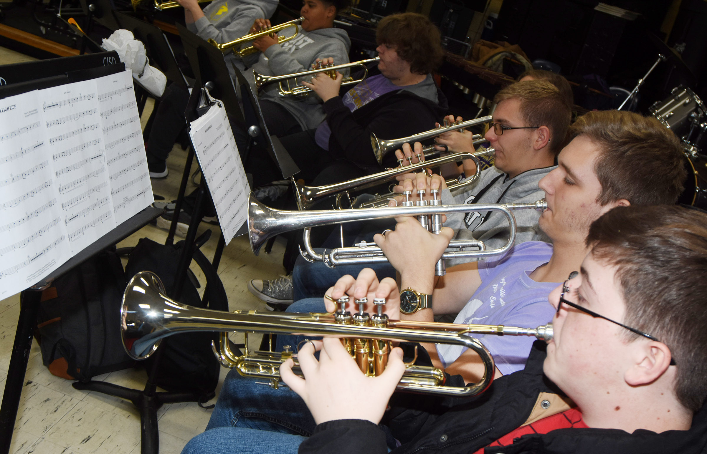 CHS junior Gavin Ford, in front, plays trumpet with his section.