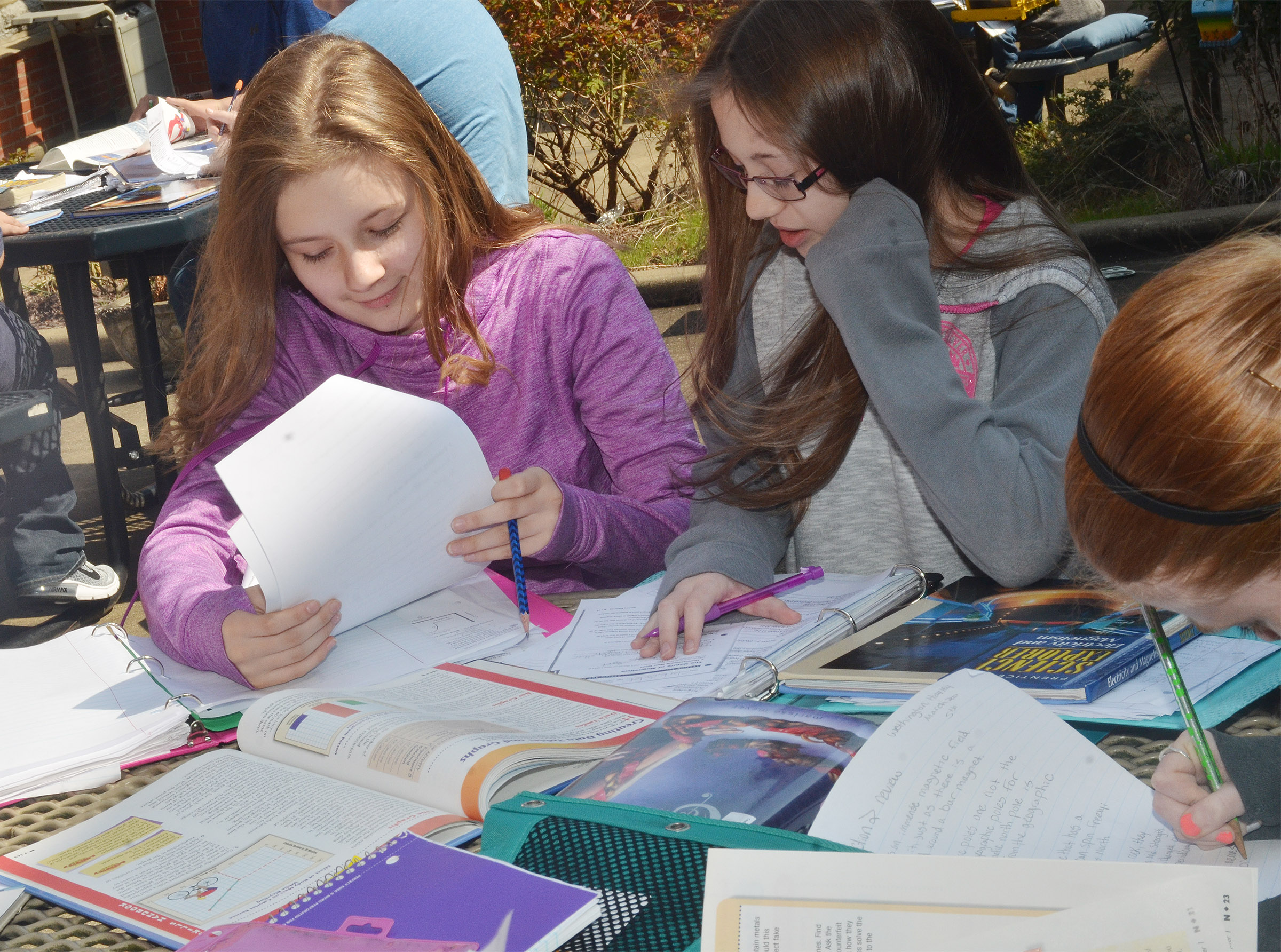 CMS seventh-graders Serenity Ford, at left, and Cailet Clark study together.