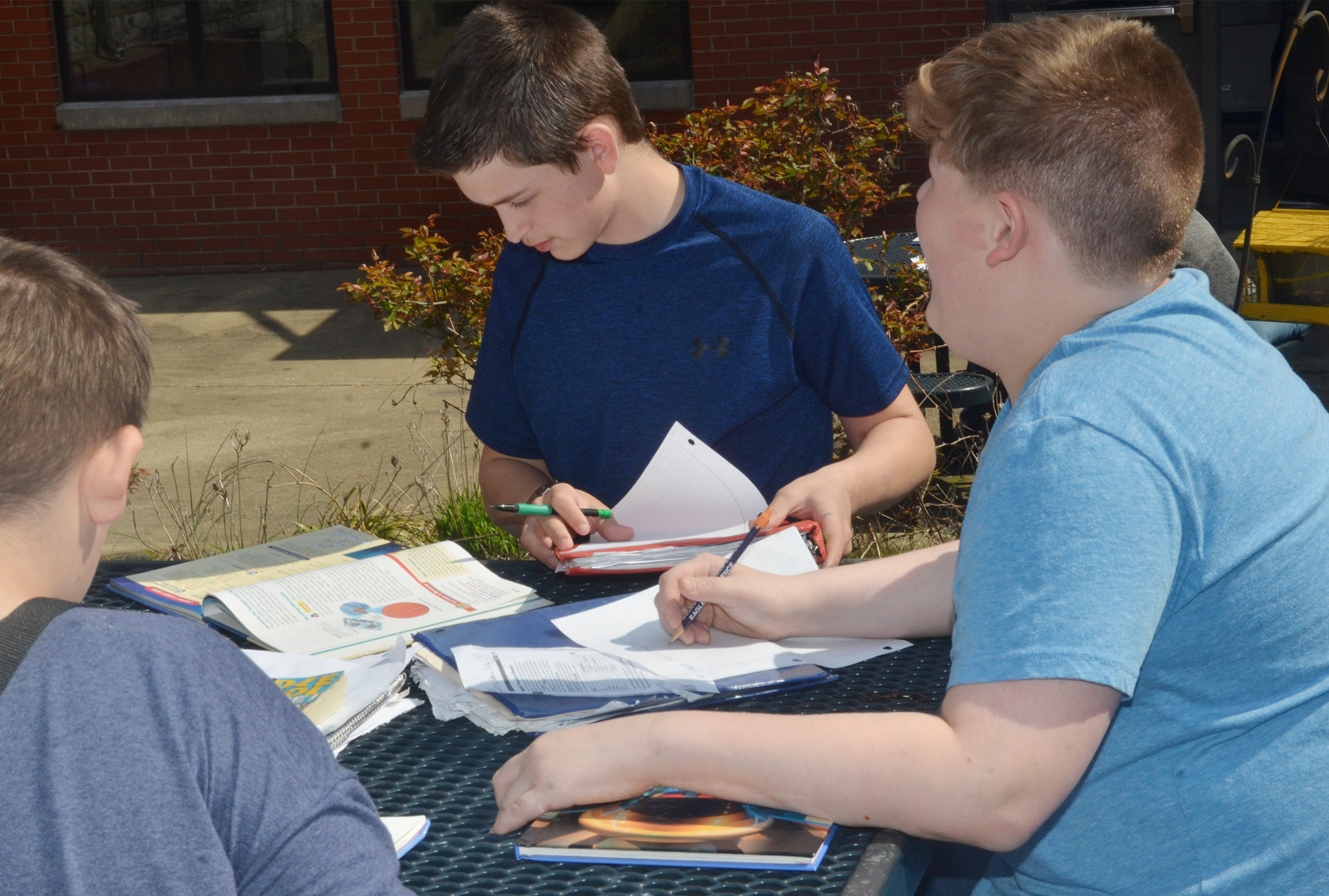 CMS seventh-graders Caden Cowherd, at left, and Blake Settle study together.