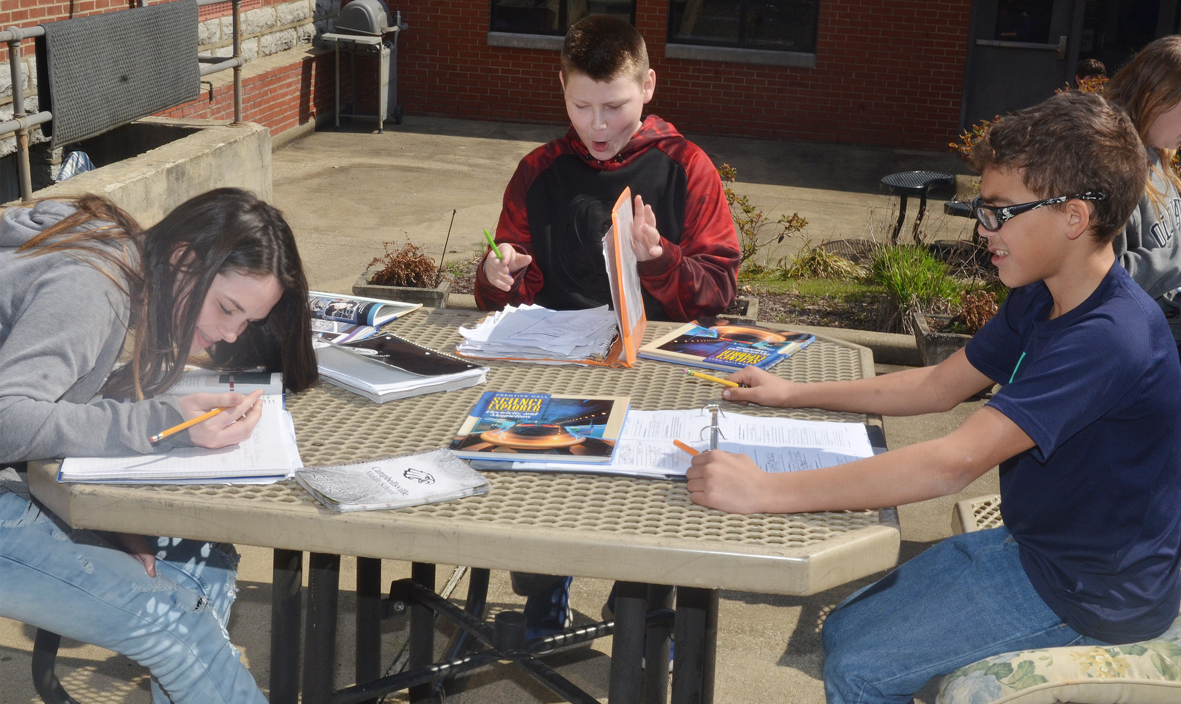 From left, CMS seventh-graders Destiny Agee, Bailey Stearman and Logan Phillips study together.