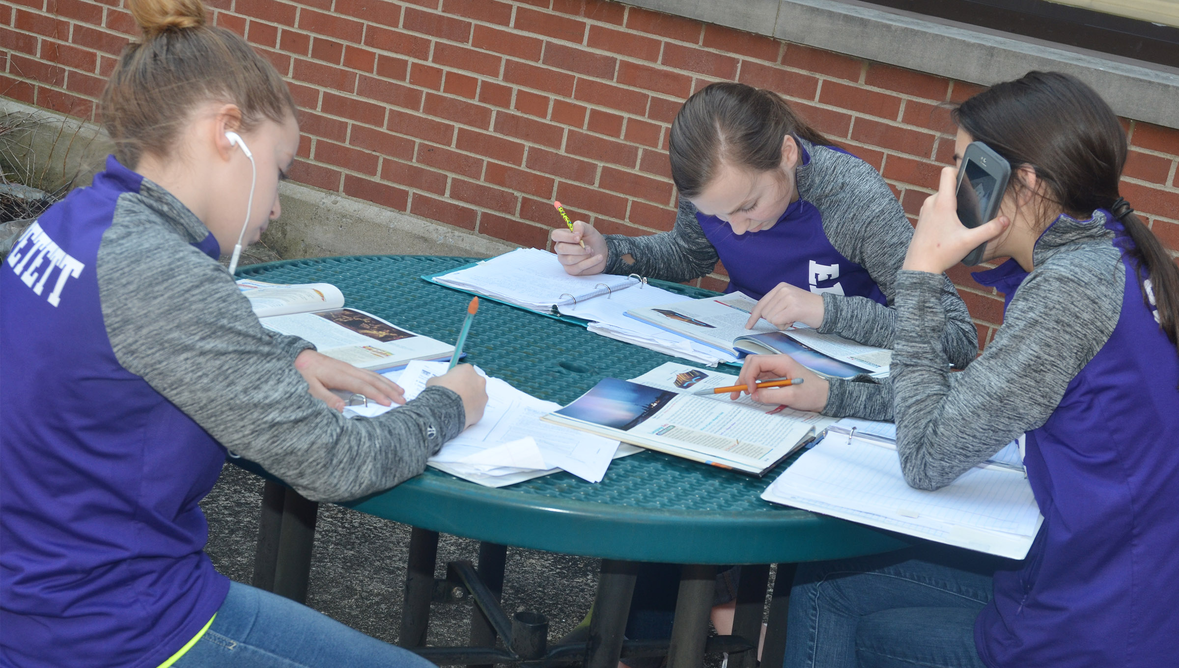 From left, CMS seventh-graders Rylee Petett, Lainey Watson and Kaylyn Smith study together.