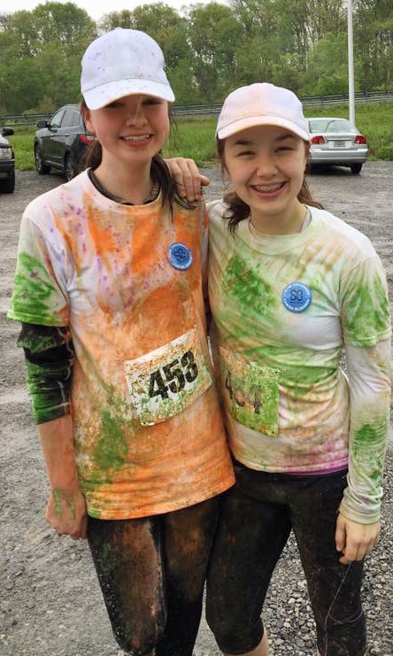 "Campbellsville Middle School seventh-graders Karley Morris, at left, and Olivia Fields recently helped raise money for children's cancer research by participating in the community's ""Color to Conquer"" run. At the beginning of the race, their shirts were white. But at the end, the shirts were very colorful."