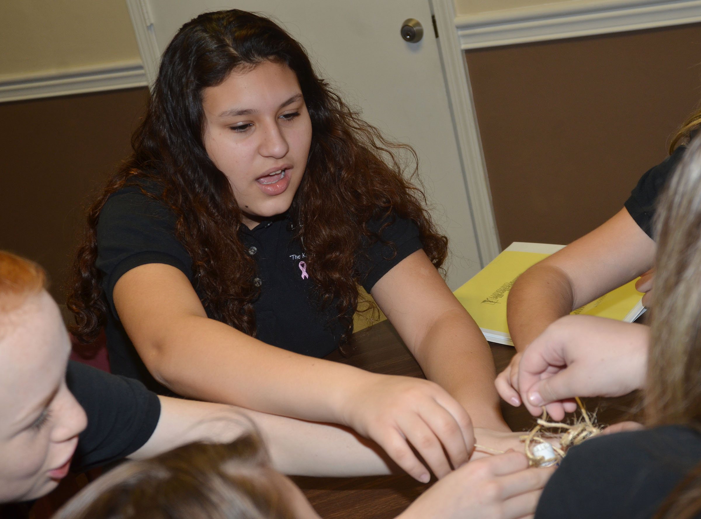 CMS eighth-grader Ana Clara Moura participates in the string team-building exercise.