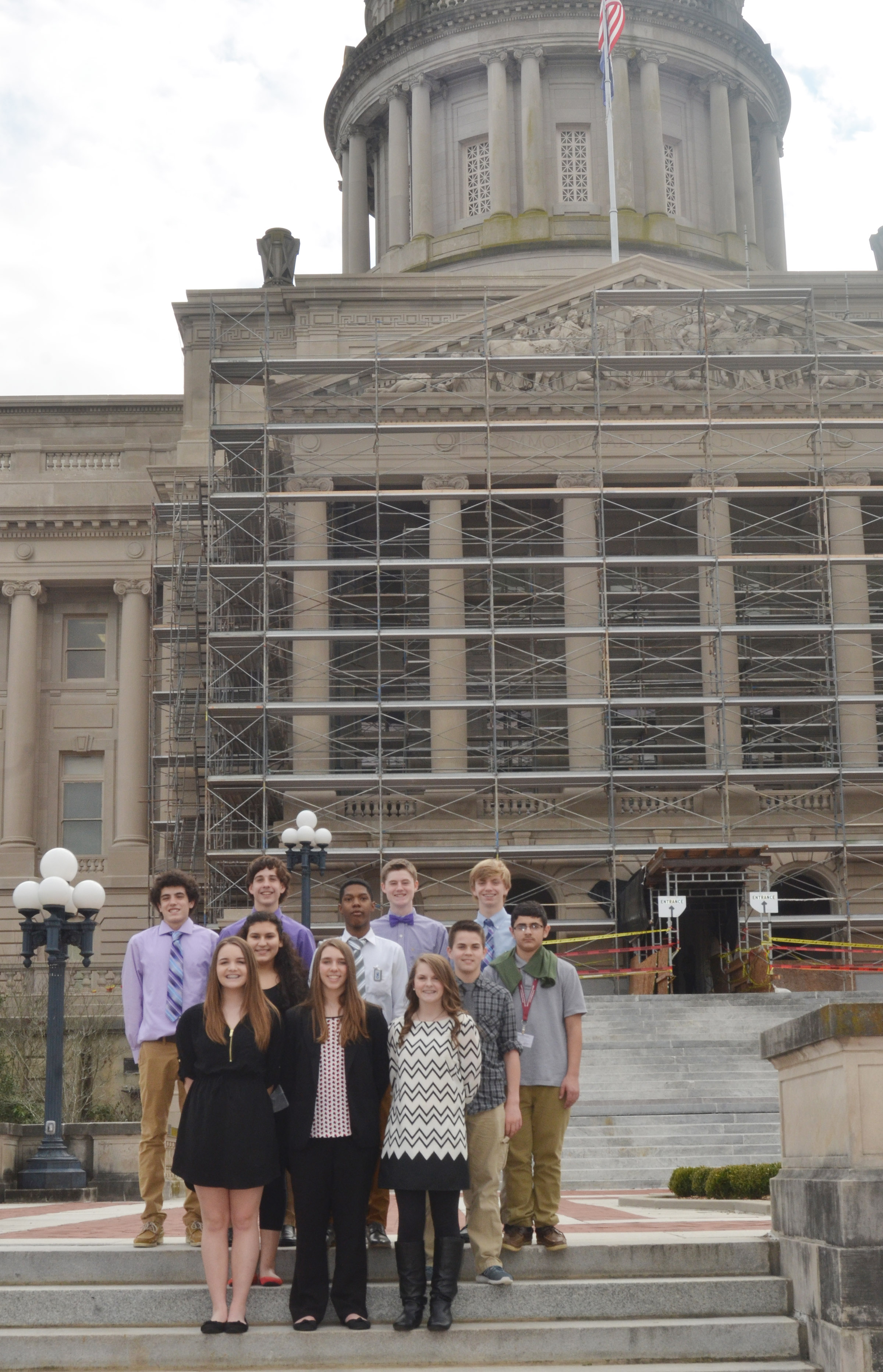 CMS CU leadership students pose for a photo outside the Kentucky capitol. From left, front, are Kenzi Forbis, Abi Wiedewitsch and Taylor Knight. Second row, Anna Clara Moura, Zaquan Cowan, Clark Kidwell and Hassan Alabusalim. Back, Kameron Smith, John Orberson, Tristin Faulkner and Arren Hash.