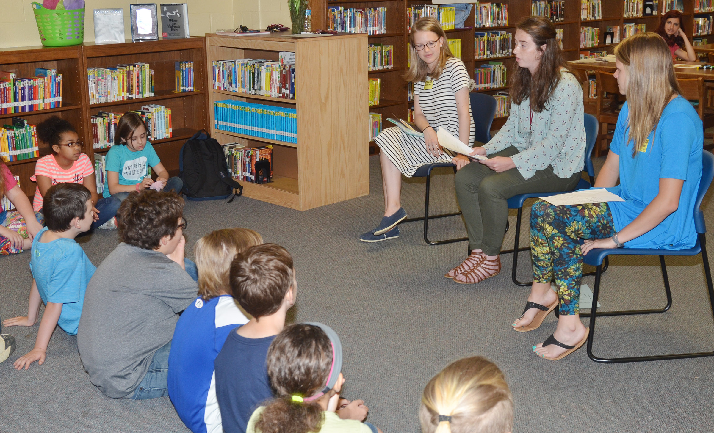 CMS fourth-graders listen to CU students discuss poetry.