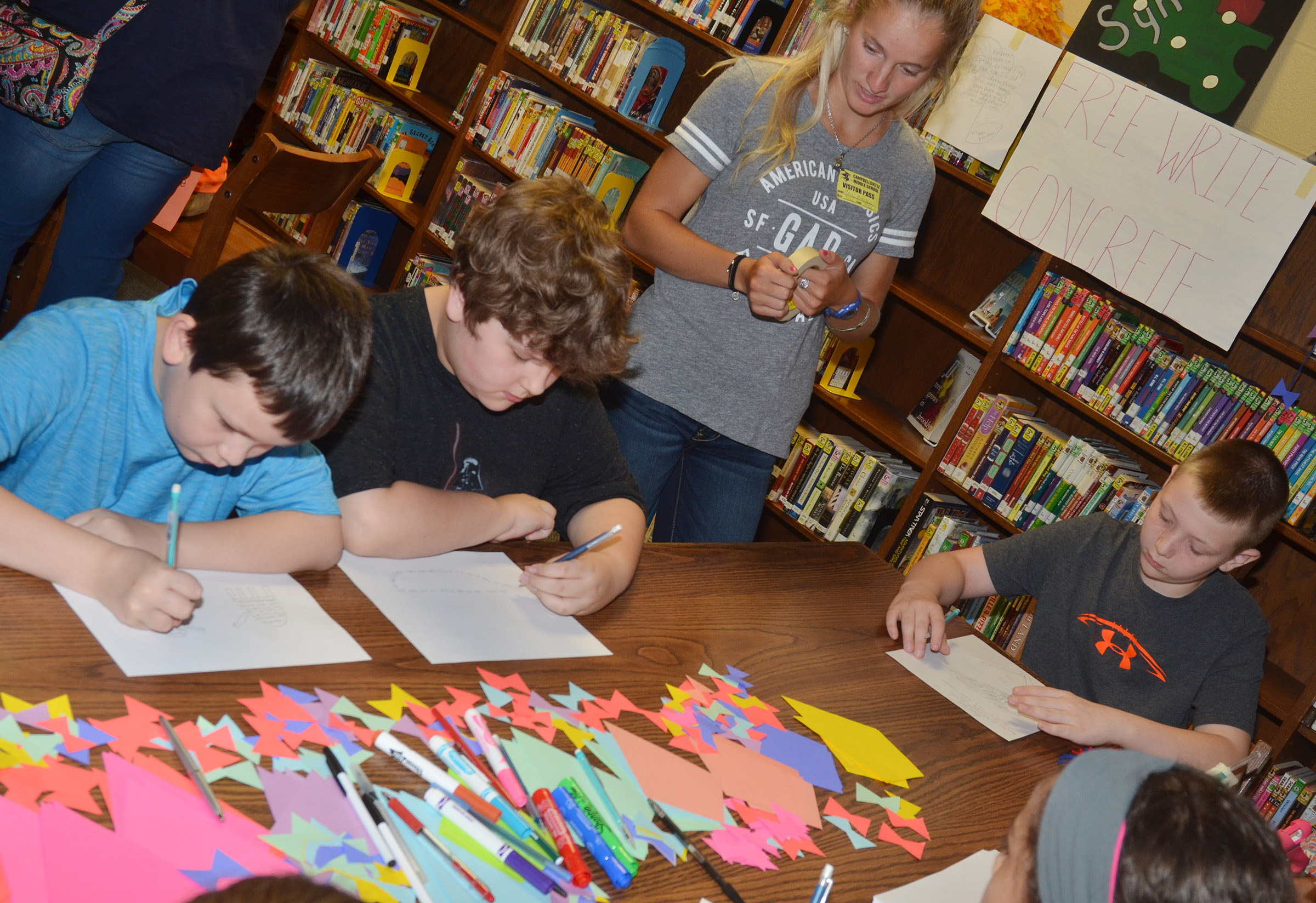 CMS fourth-graders, from left, Mason Fisher, Zeke Harris and Kaleb Miller write their free verse poetry.