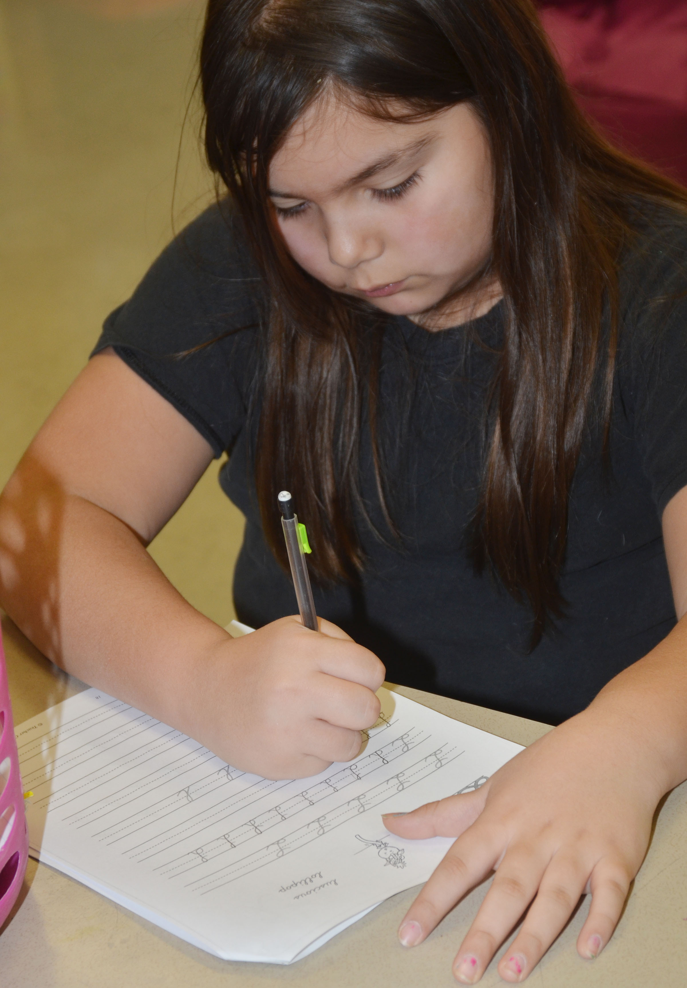 CMS fifth-grader Aaliyah Nunez practices cursive writing.