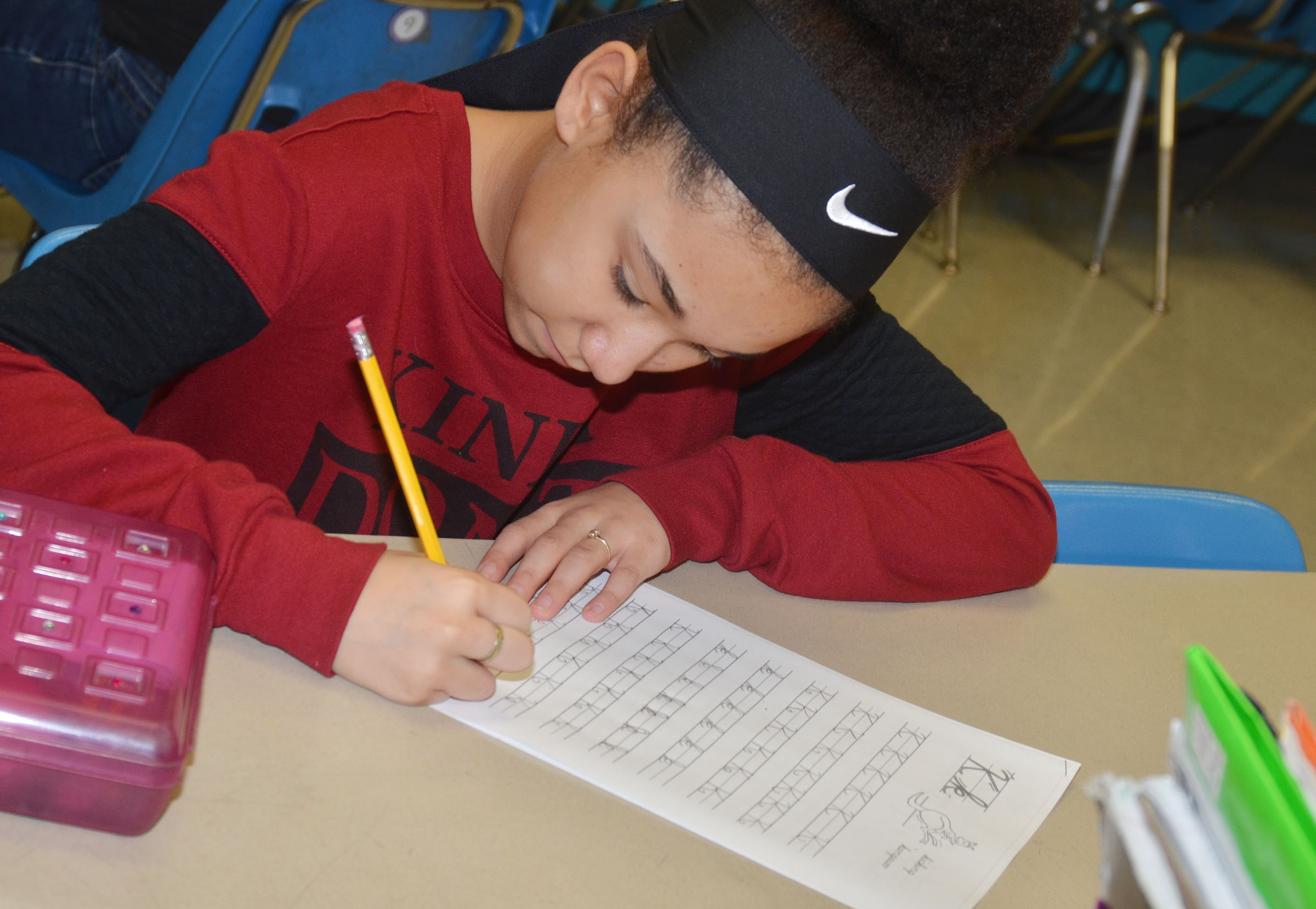 CMS fifth-grader Keely Thompson practices cursive writing.