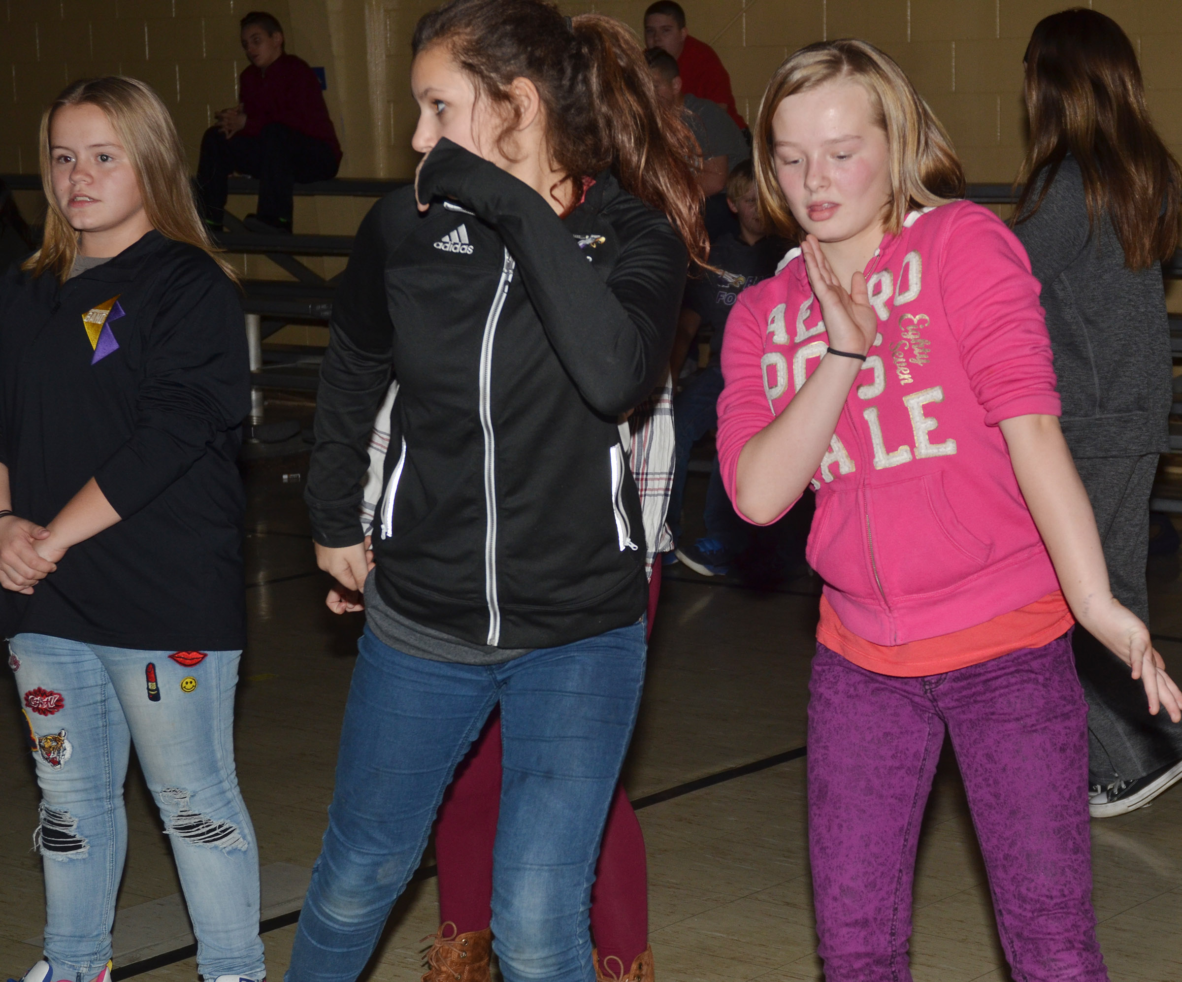 From left, CMS seventh-graders Riley Rainwater and Christina Miller and sixth-grader Davanna Reardon dance.