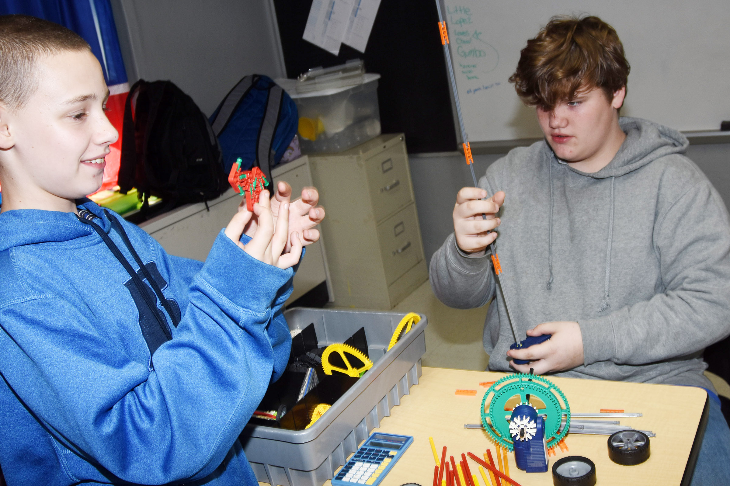 CMS eighth-graders Brandon Nelson, at left, and Gavin Morris build with K'nex blocks.