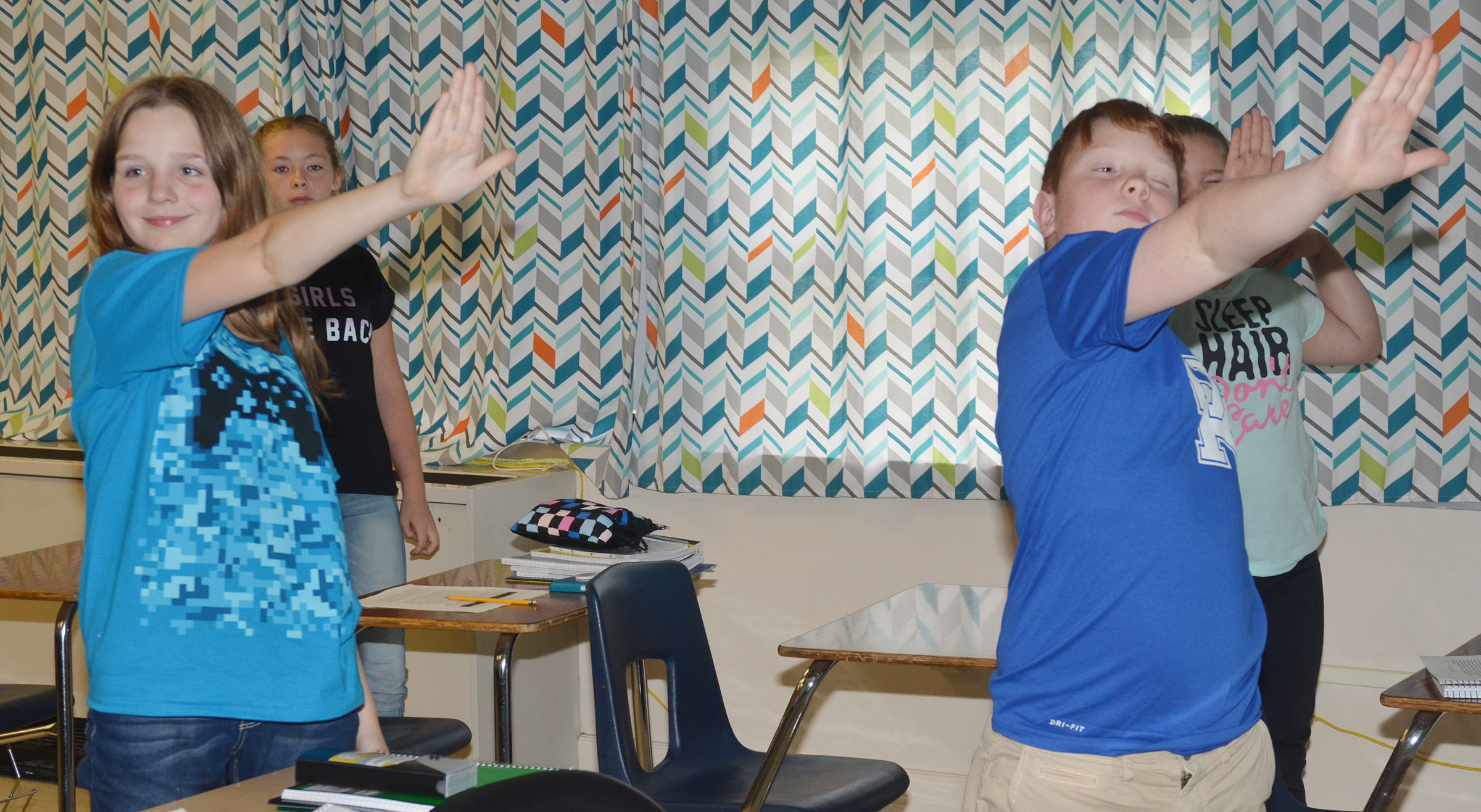 CMS sixth-graders, Mallory Parker, at left, and Conner Rinehart, and their classmates, simulate what an eclipse might look like.