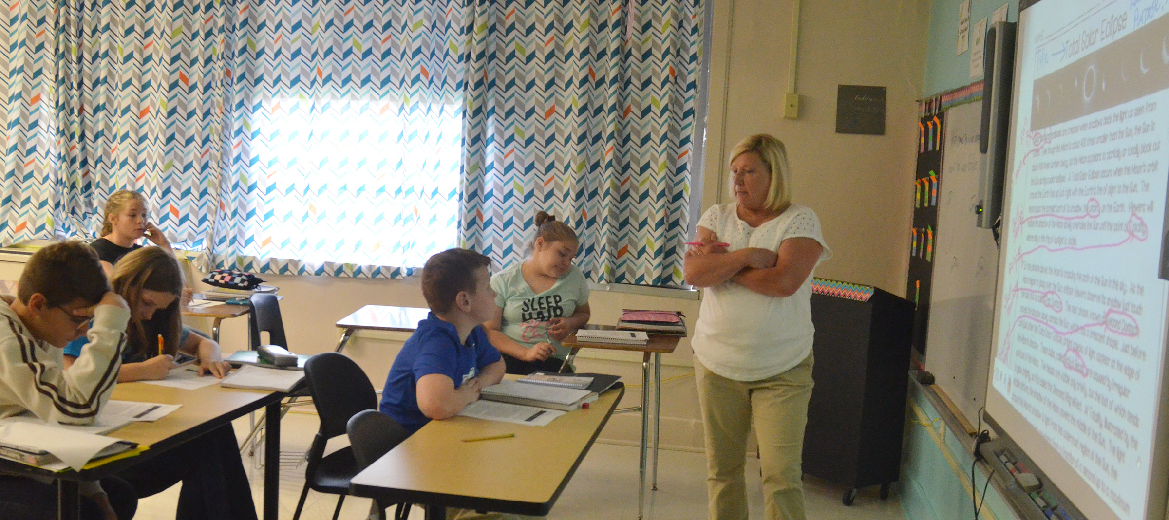 CMS teacher Jan Speer discusses what happens during a solar eclipse with her sixth-grade students.