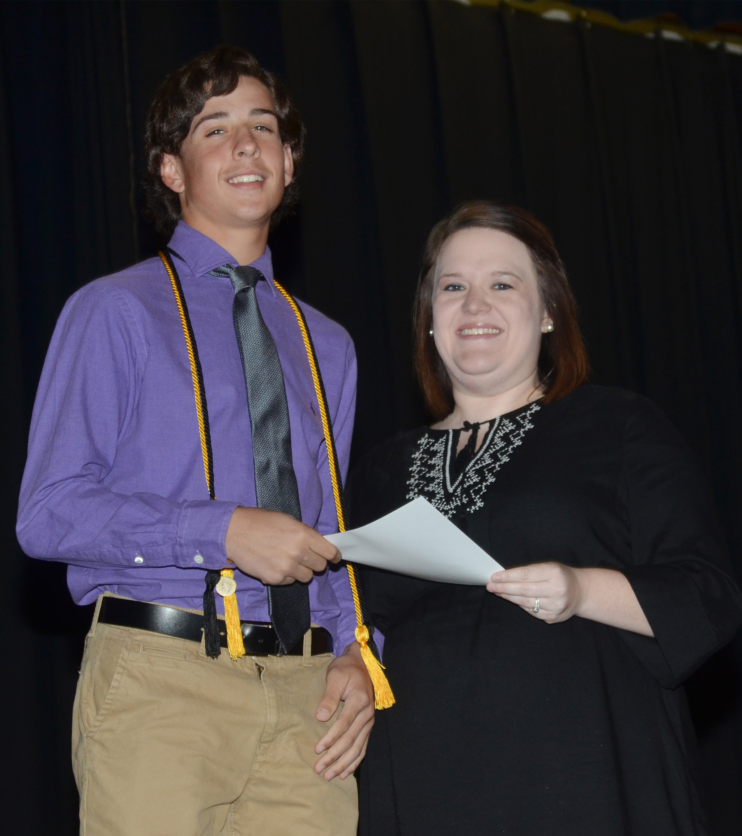 CMS eighth-grader John Orberson receives the language arts award from teacher Paige Cook.