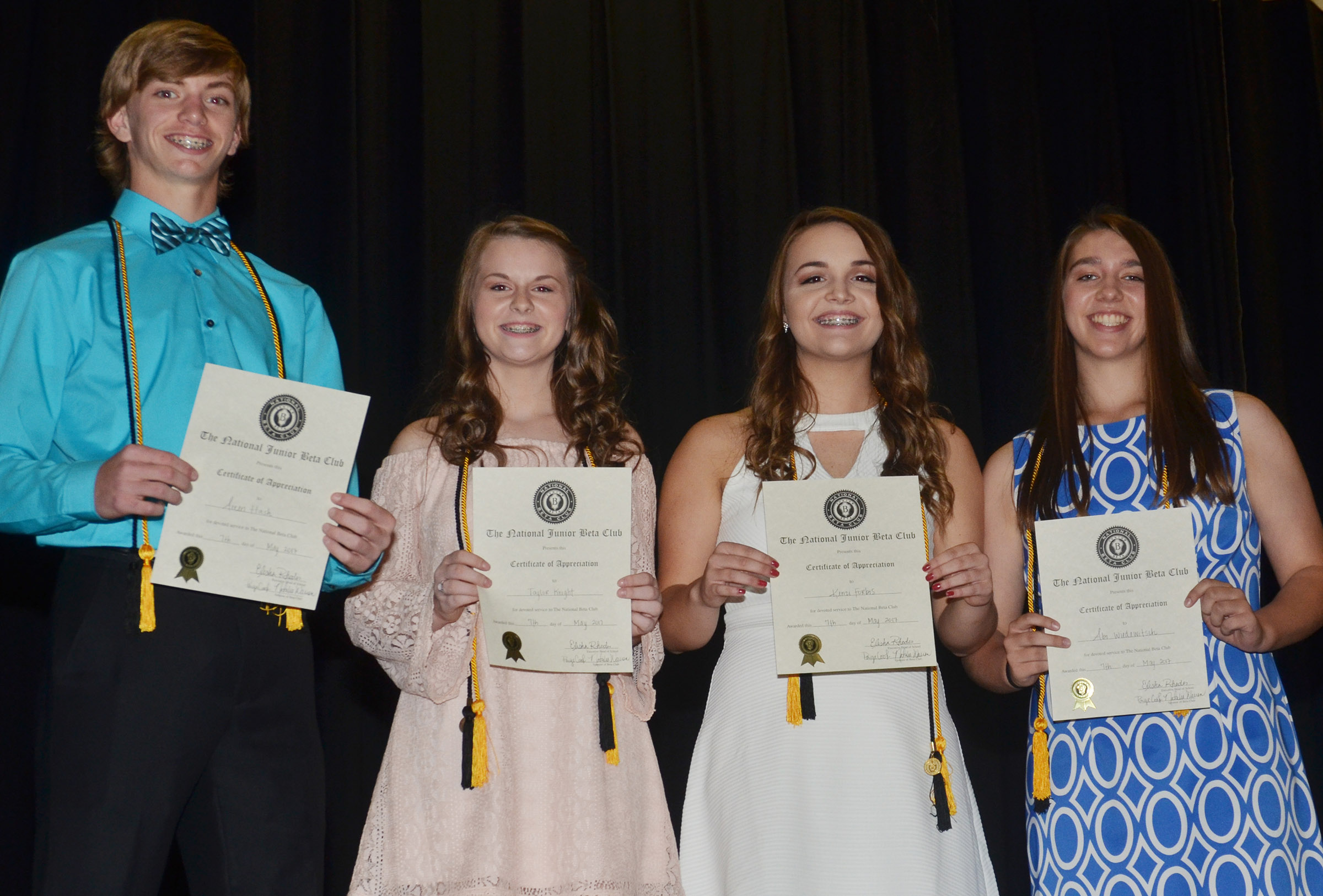 CMS eighth-graders, from left, Arren Hash, Taylor Knight, Kenzi Forbis and Abi Wiedewitsch receive BETA awards.