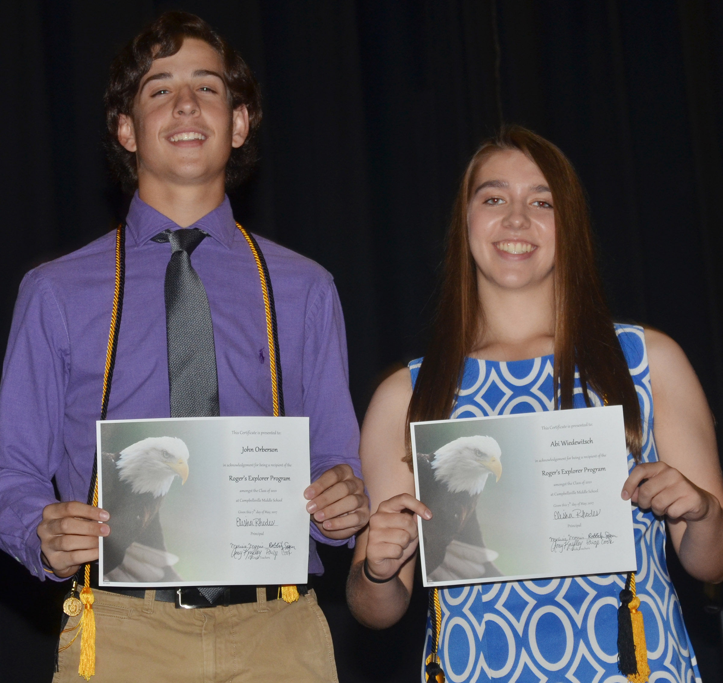 CMS eighth-graders John Orberson and Abi Wiedewitsch are honored for being chosen to attend the Rogers Explorer program this summer.
