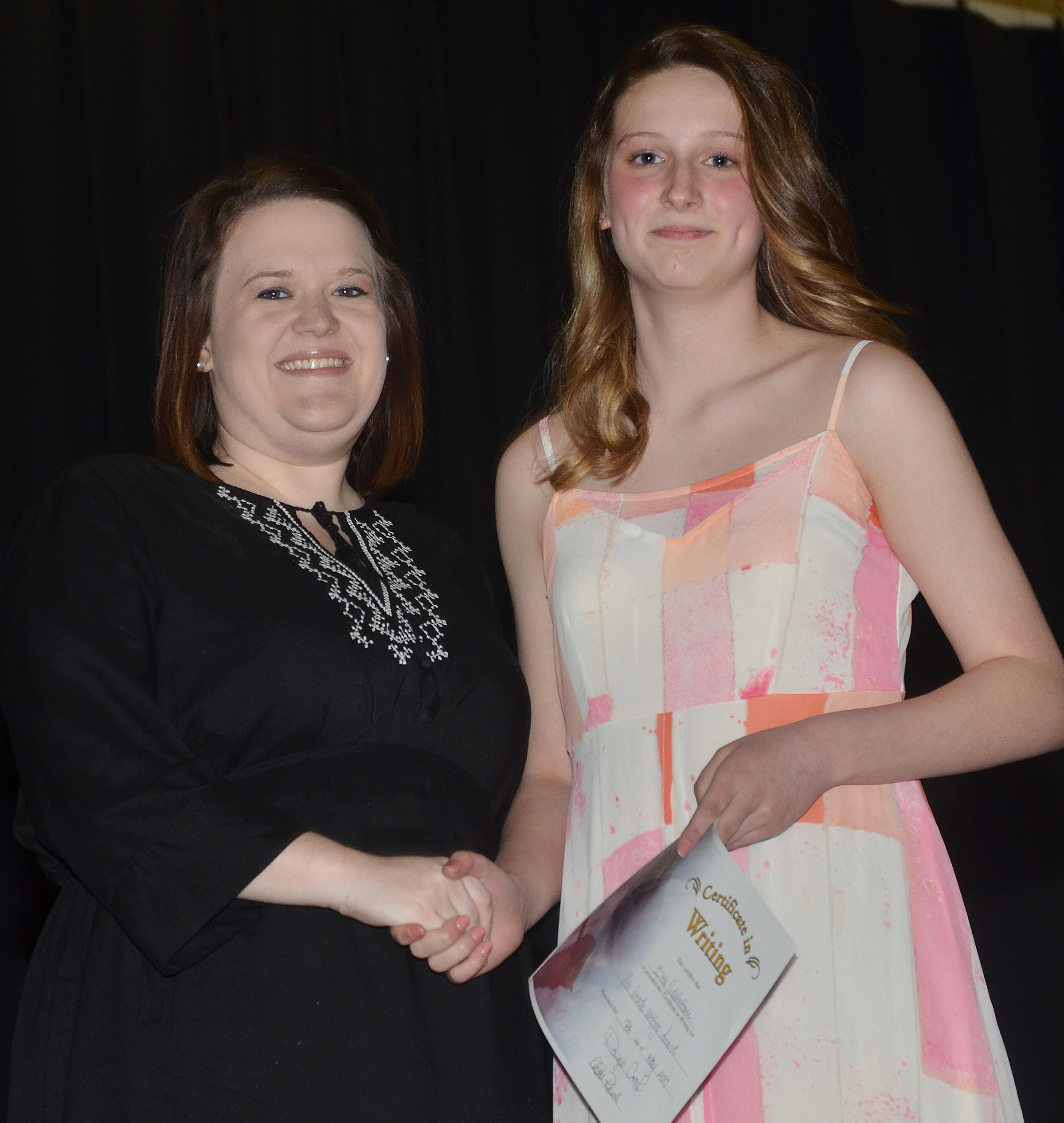 CMS eighth-grader Zoie Sidebottom receives the writing award from teacher Paige Cook.