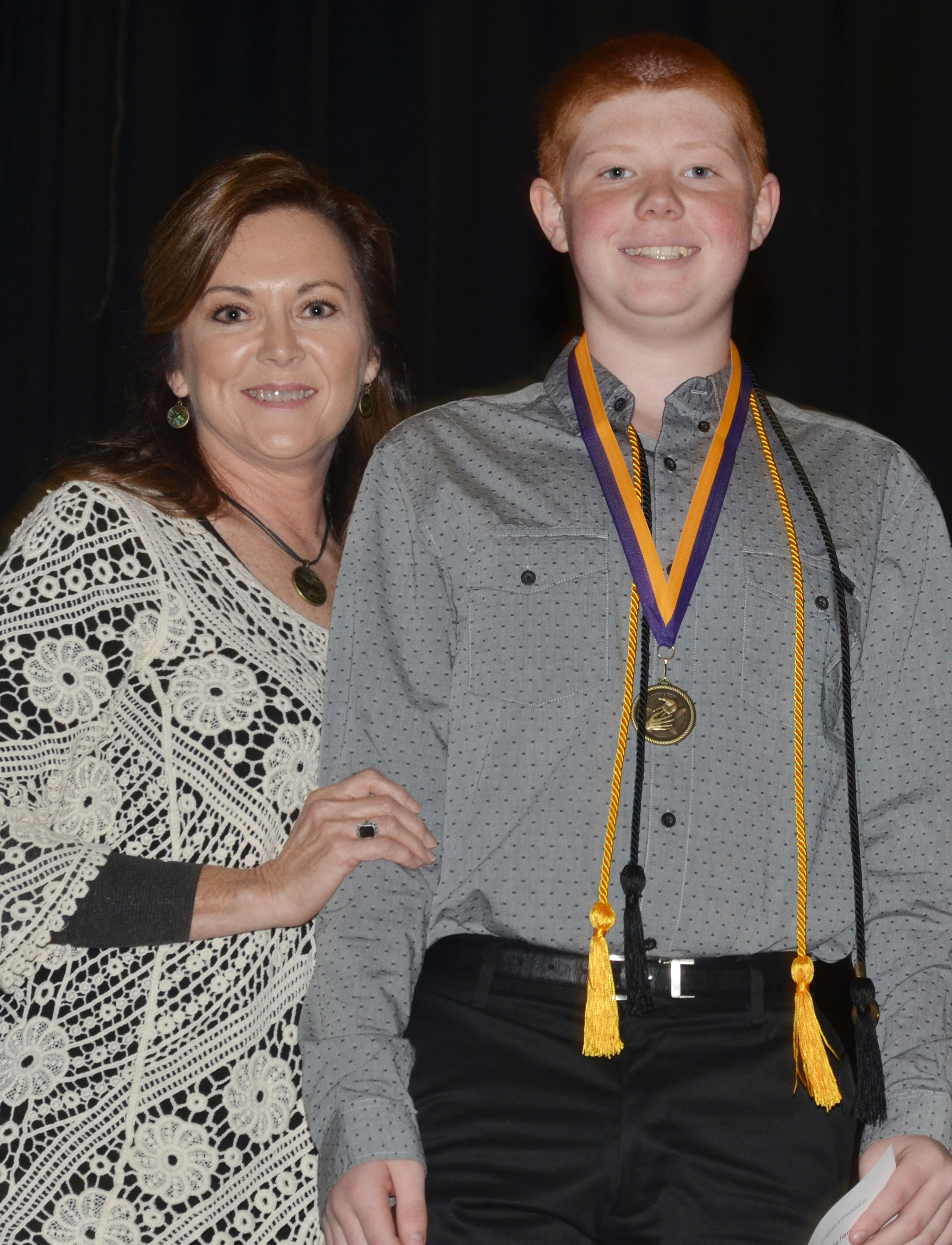 CMS eighth-grader Colin Harris receives the cooperation award from teacher Melisa Morris.